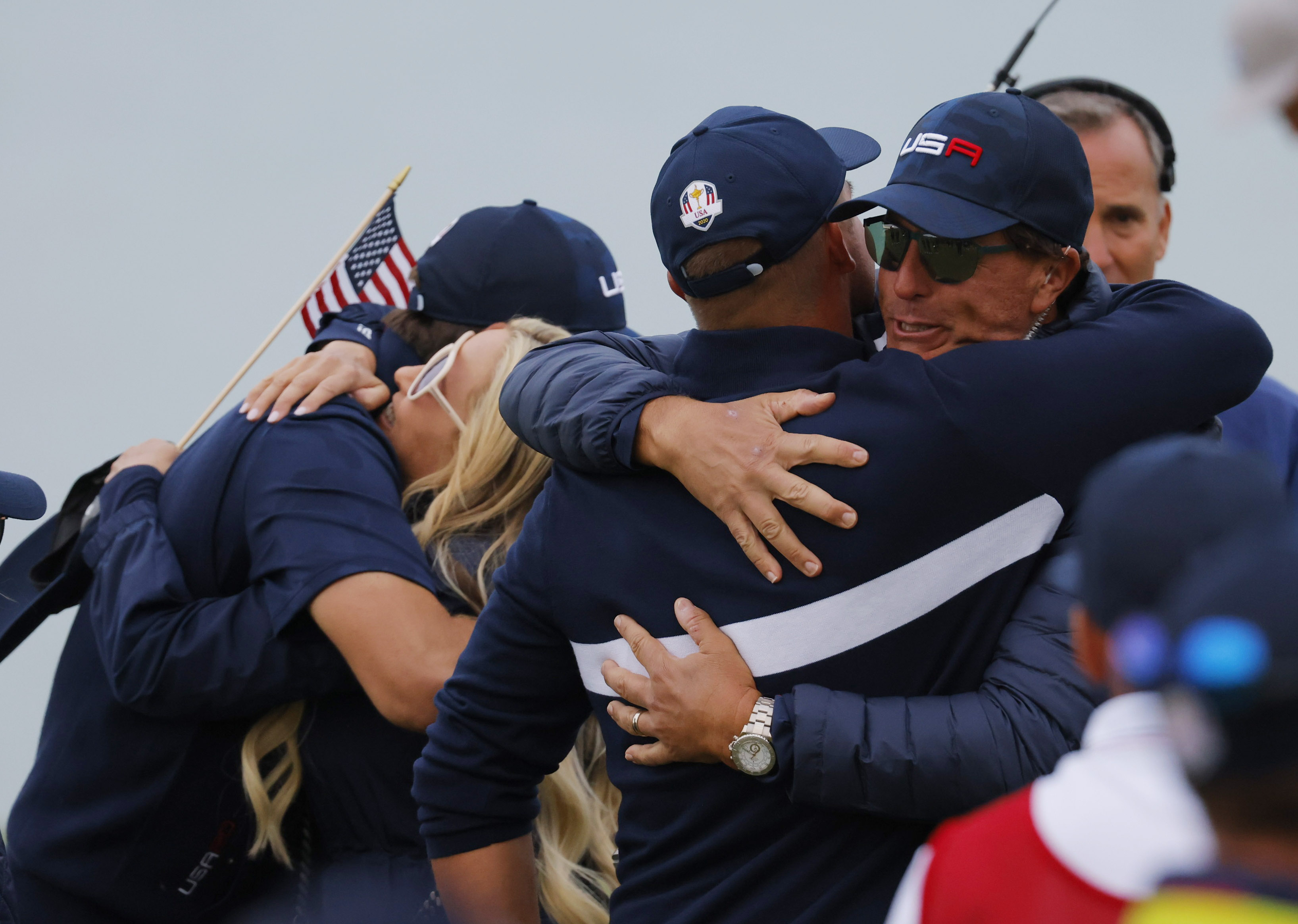 Golf - The 2020 Ryder Cup - Whistling Straits, Sheboygan, Wisconsin, U.S. - September 25, 2021 Team USA's Bryson DeChambeau celebrates with Team USA vice captain Phil Mickelson on the 17th green after winning the match during the Four-balls REUTERS/Mike Segar