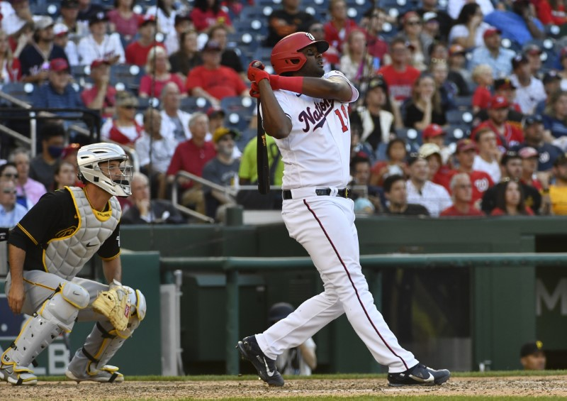 Jun 16, 2021; Washington, District of Columbia, USA; Washington Nationals first baseman Josh Bell (19) hits a two-run home run against the Pittsburgh Pirates during the seventh inning at Nationals Park. Mandatory Credit: Brad Mills-USA TODAY Sports