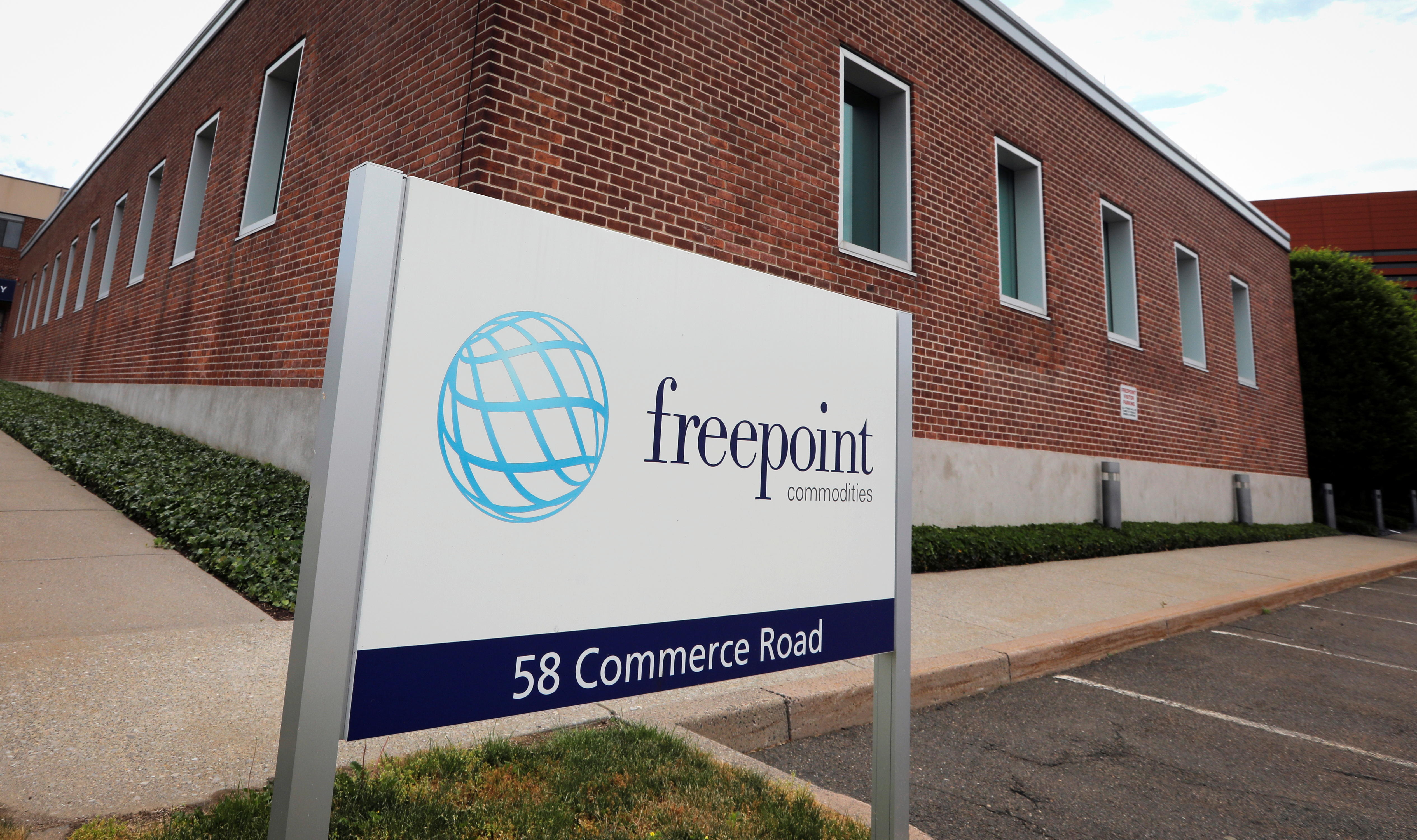 A sign with the logo of Freepoint Commodities LLC is pictured outside the company's headquarters in Stamford, Connecticut, U.S., May 28, 2021. Picture taken May 28, 2021. REUTERS/Mike Segar