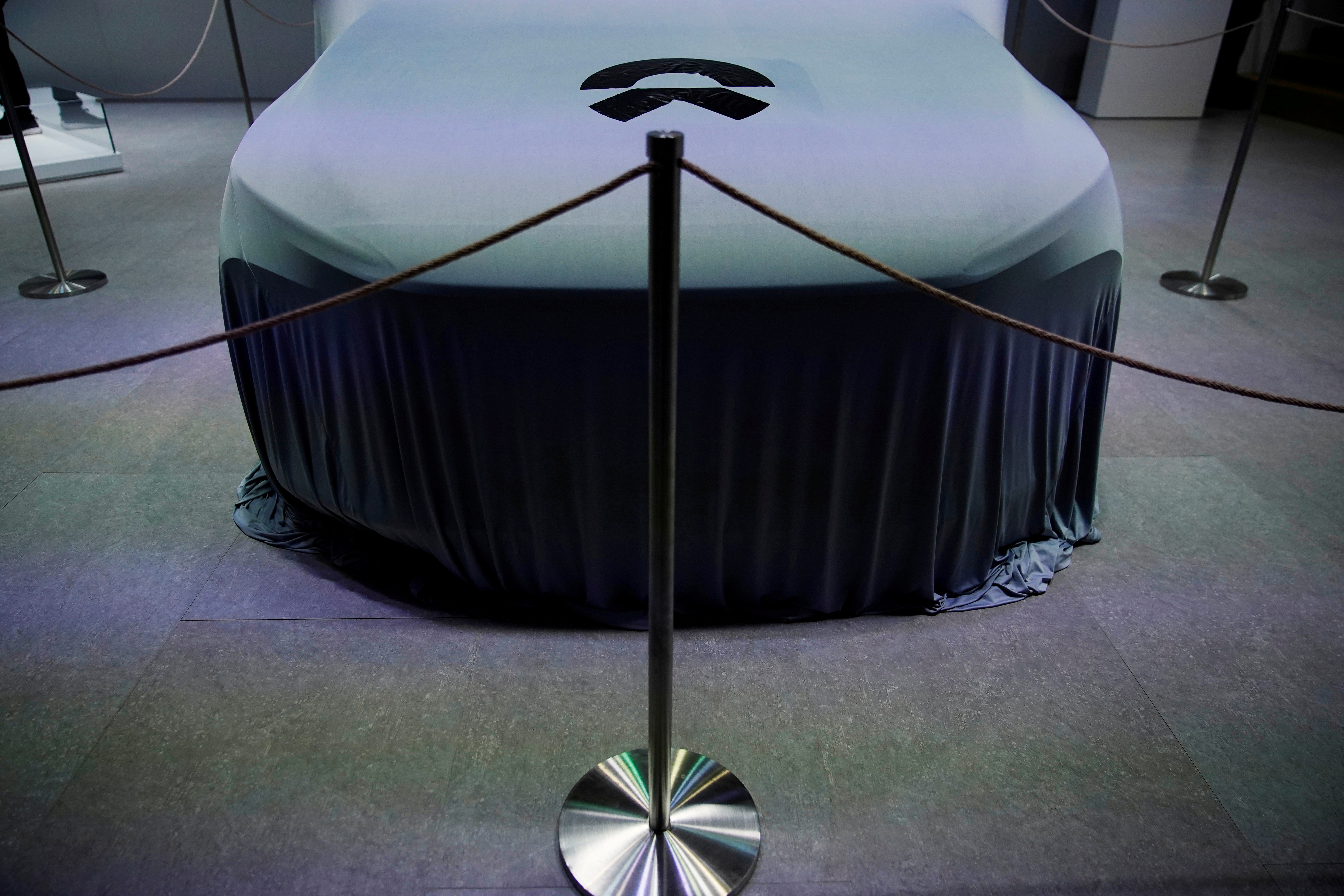 The Nio logo is seen on a cover during a media day for the Auto Shanghai show in Shanghai, China April 19, 2021. REUTERS/Aly Song/File Photo