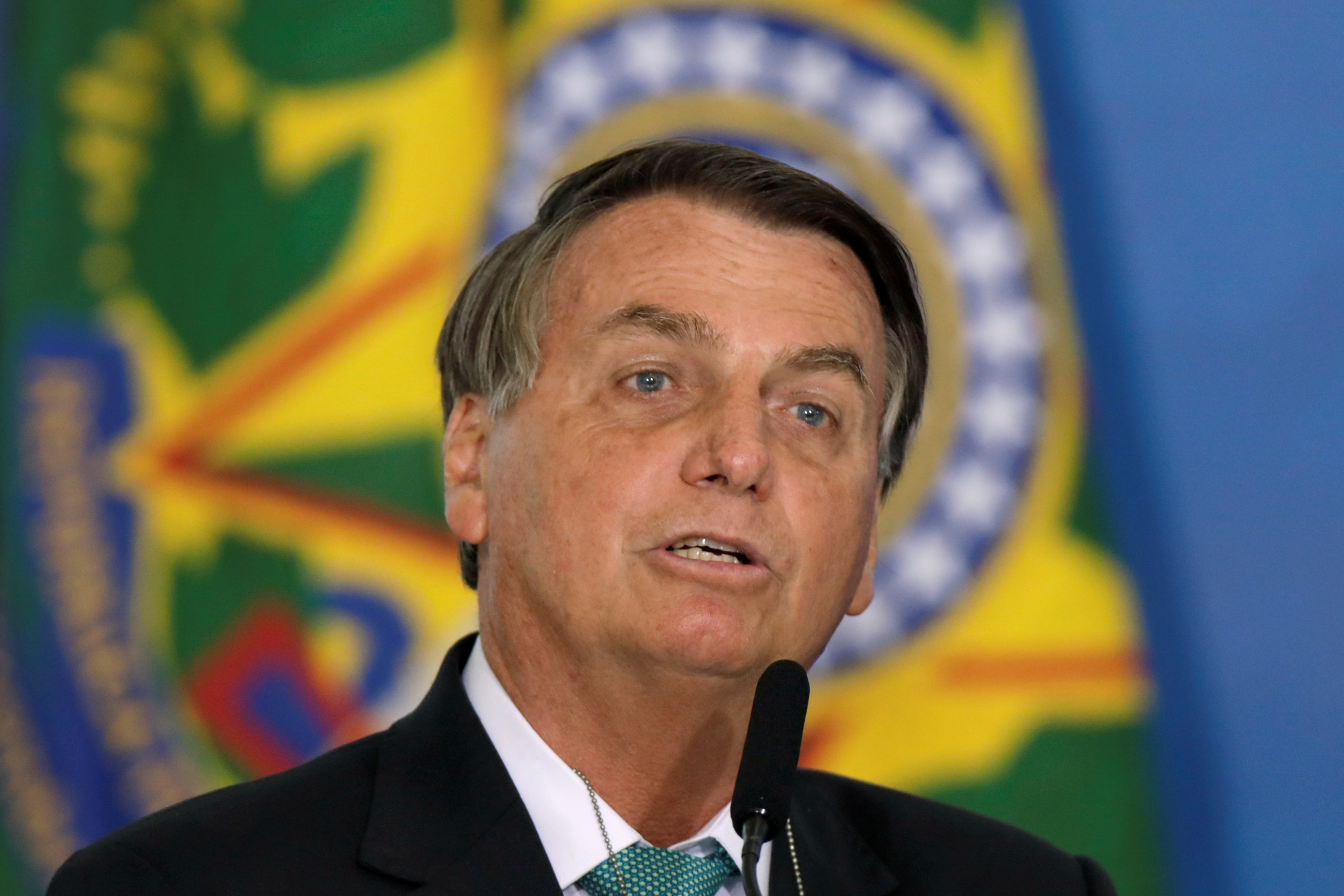 Brazil's President Jair Bolsonaro speaks about the countrys hosting the 2021 Copa America during a ceremony announcing the Caixa public bank sponsorship of Brazilian sport, in Brasilia, at the Planalto Palace in Brasilia, Brazil, June 1, 2021. REUTERS/Ueslei Marcelino