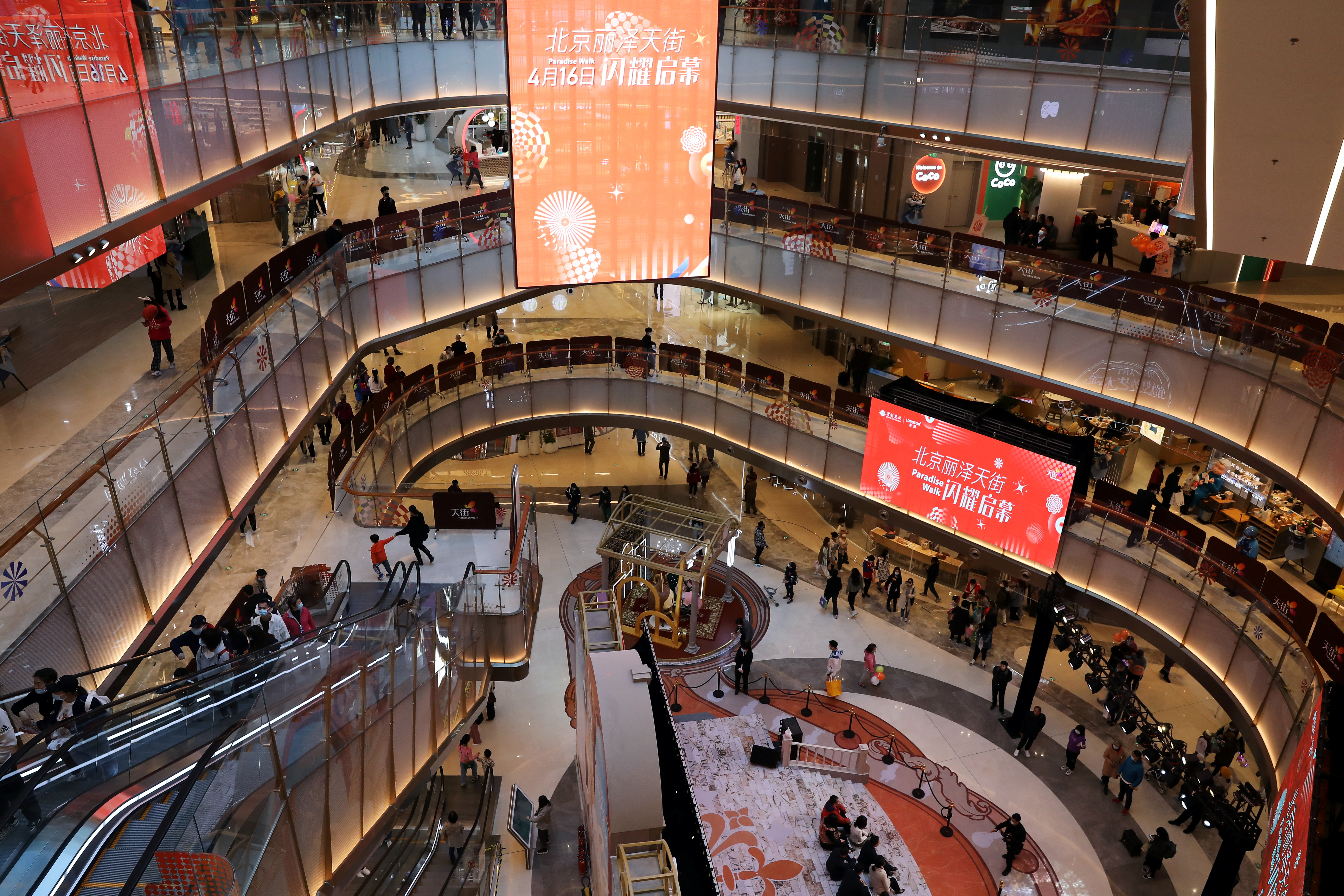 People visit a newly opened shopping mall in Beijing, China April 16, 2021. REUTERS/Tingshu Wang