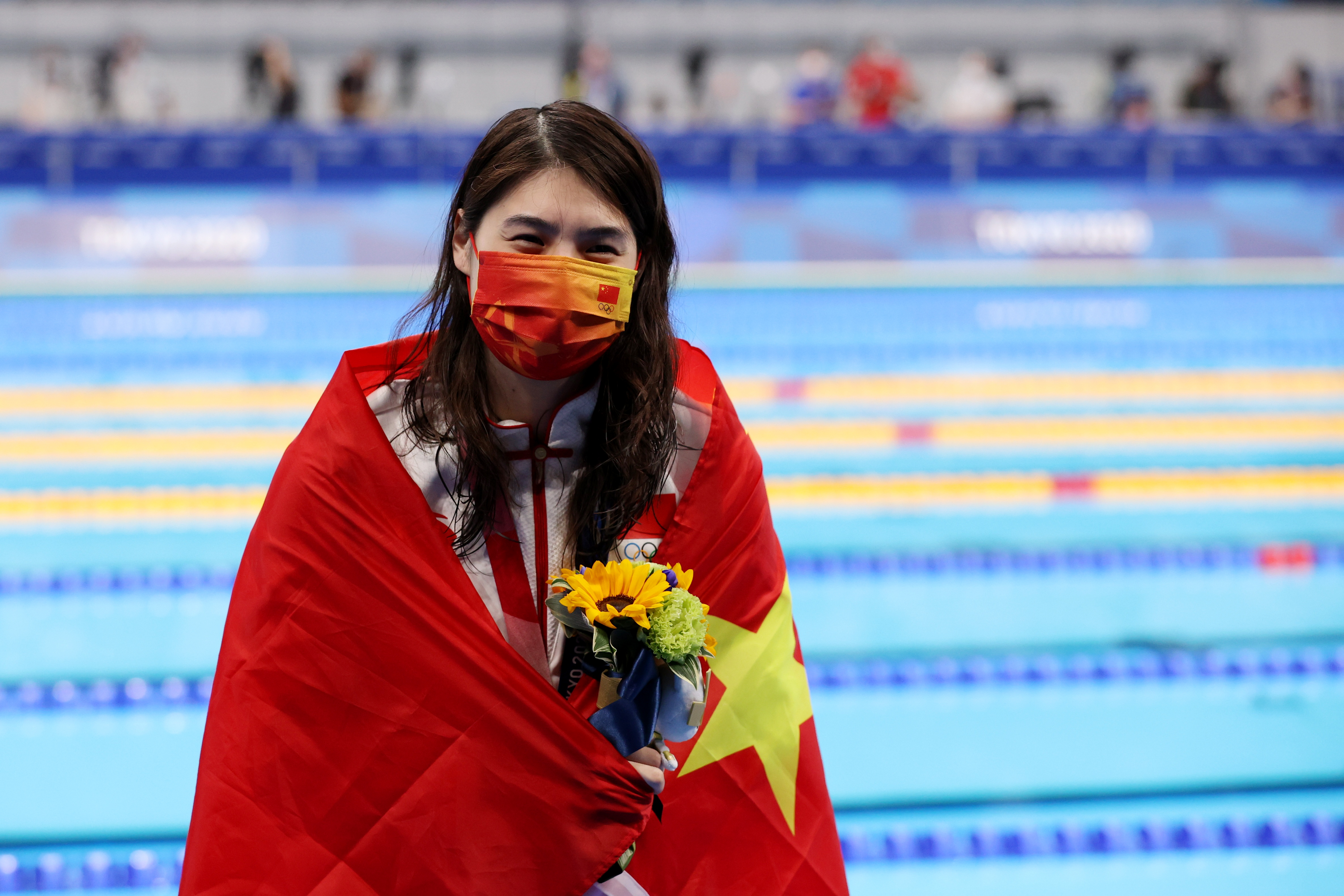 Tokyo 2020 Olympics - Swimming - Women's 200m Butterfly - Medal Ceremony - Tokyo Aquatics Centre - Tokyo, Japan - July 29, 2021. Gold medalist Zhang Yufei of China celebrates on the podium REUTERS/Molly Darlington