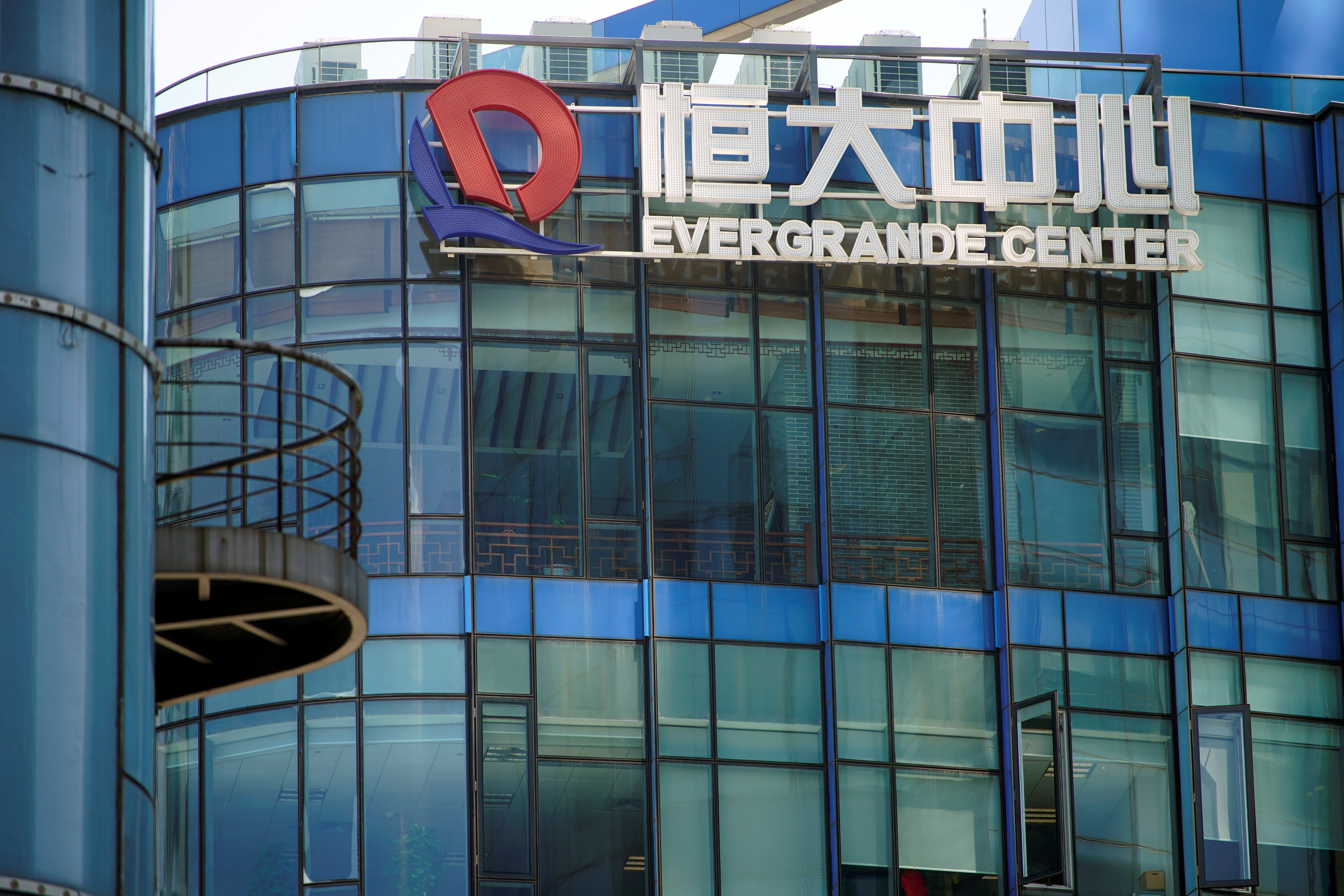 The logo of China Evergrande Group seen on the Evergrande Center in Shanghai, China September 22, 2021. REUTERS/Aly Song REFILE - QUALITY REPEAT