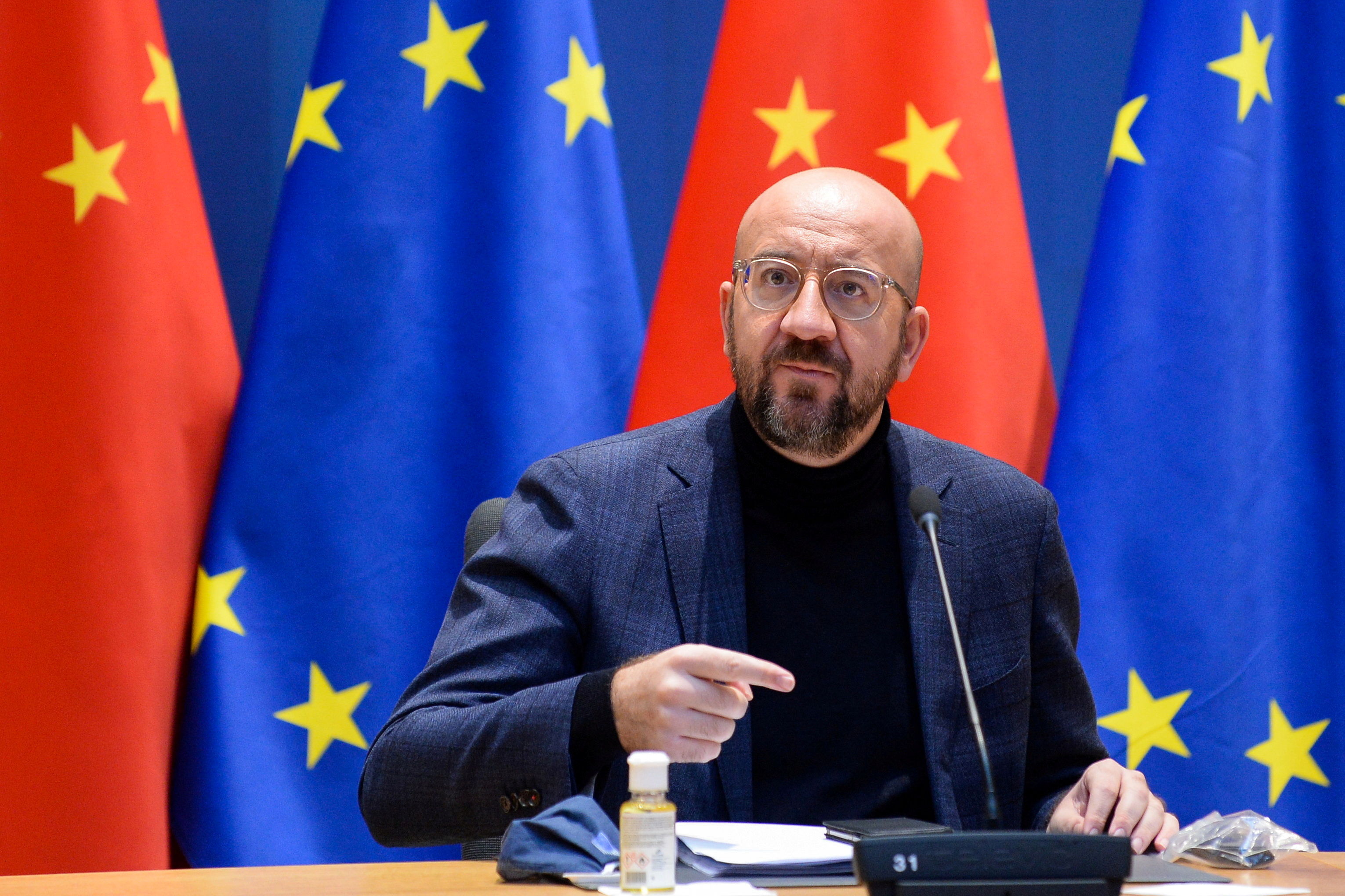 European Council President Charles Michel gestures during a video conference with European Commission President Ursula von der Leyen, German Chancellor Angela Merkel, French President Emmanuel Macron and Chinese President Xi Jinping, in Brussels, Belgium December 30, 2020. REUTERS/Johanna Geron/Pool/File Photo