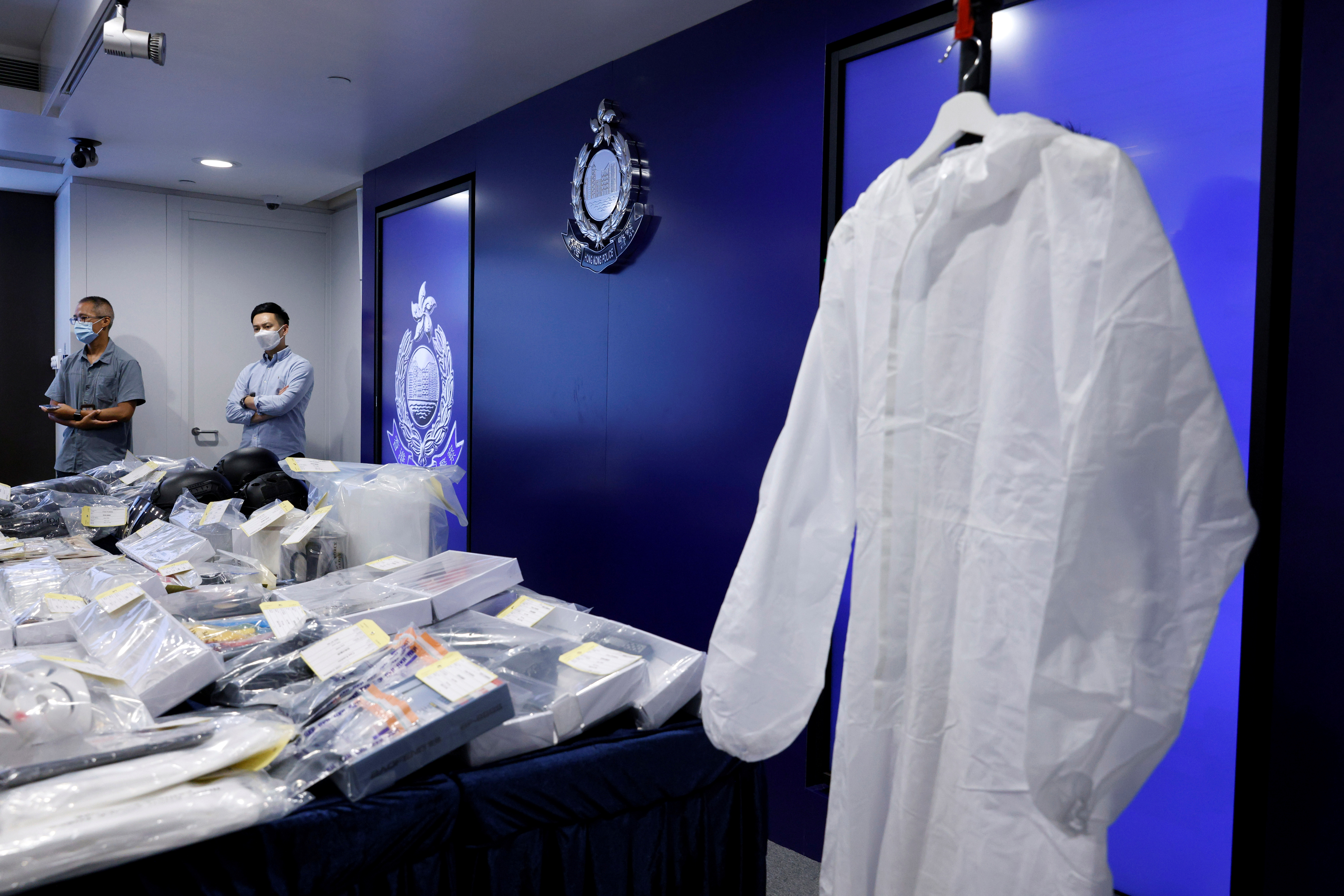 Evidence is seen during a news conference after police's National Security Department arrested nine people they said are suspected of terrorist activities, in Hong Kong, China July 6, 2021. REUTERS/Tyrone Siu