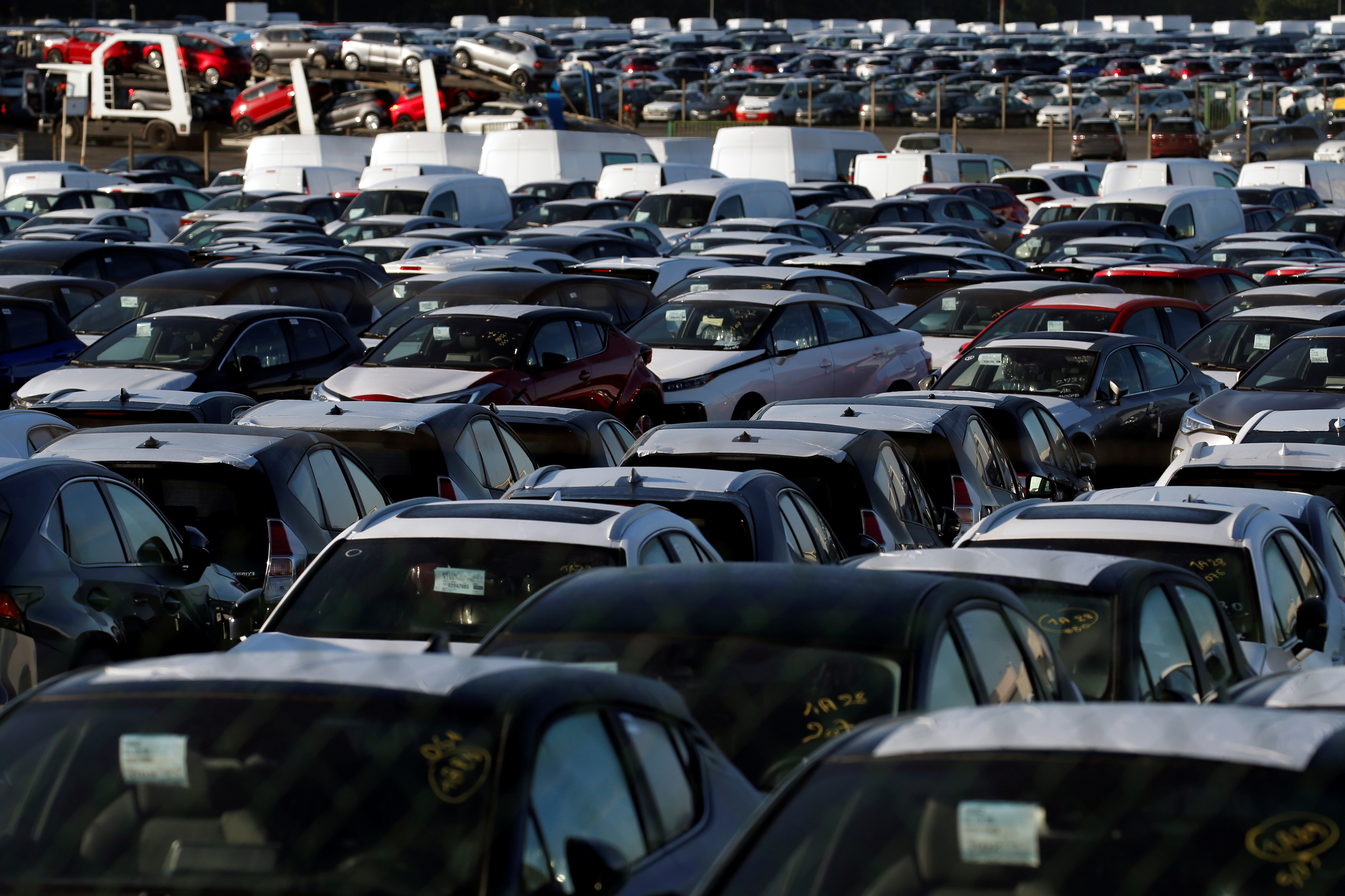 Stocks of new cars are parked in a lot, at Walon France automobile transport company in Hordain, northern France, May 26, 2020. REUTERS/Pascal Rossignol