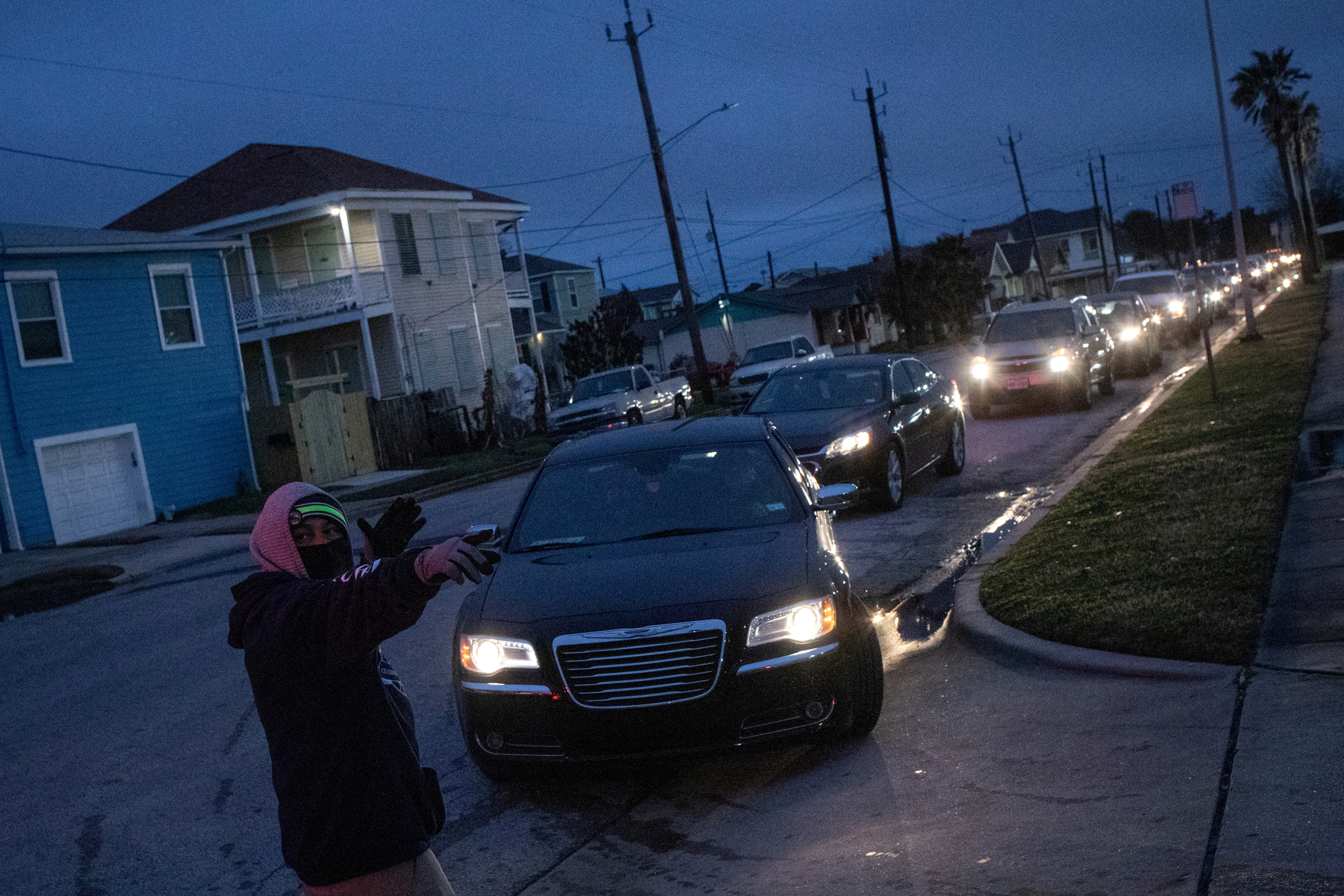 Residents line up in their vehicles to enter a warming center and shelter after record-breaking winter temperatures, as local media reports most residents are without electricity, in Galveston, Texas, U.S., February 17, 2021. REUTERS/Adrees Latif