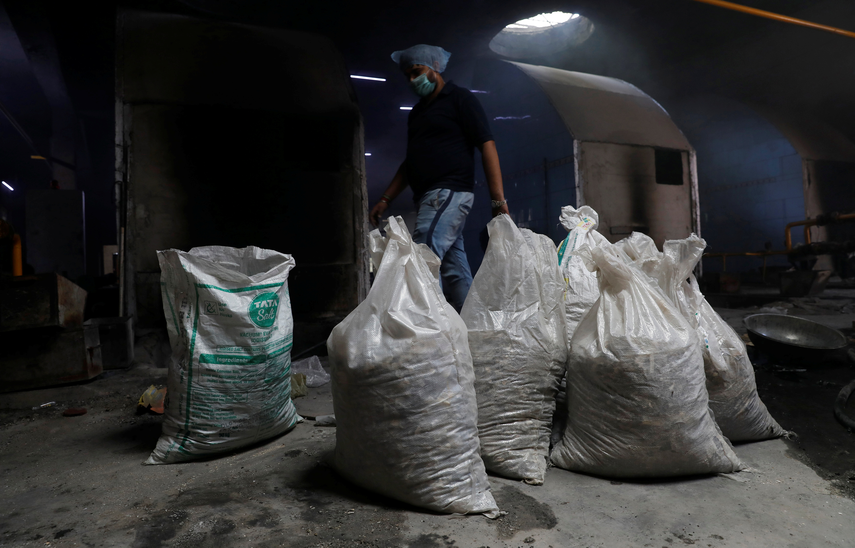 Bags containing unclaimed ashes of victims who died from the coronavirus disease (COVID-19), are seen at a crematorium in New Delhi, India, May 9, 2021. Picture taken May 9, 2021. REUTERS/Adnan Abidi