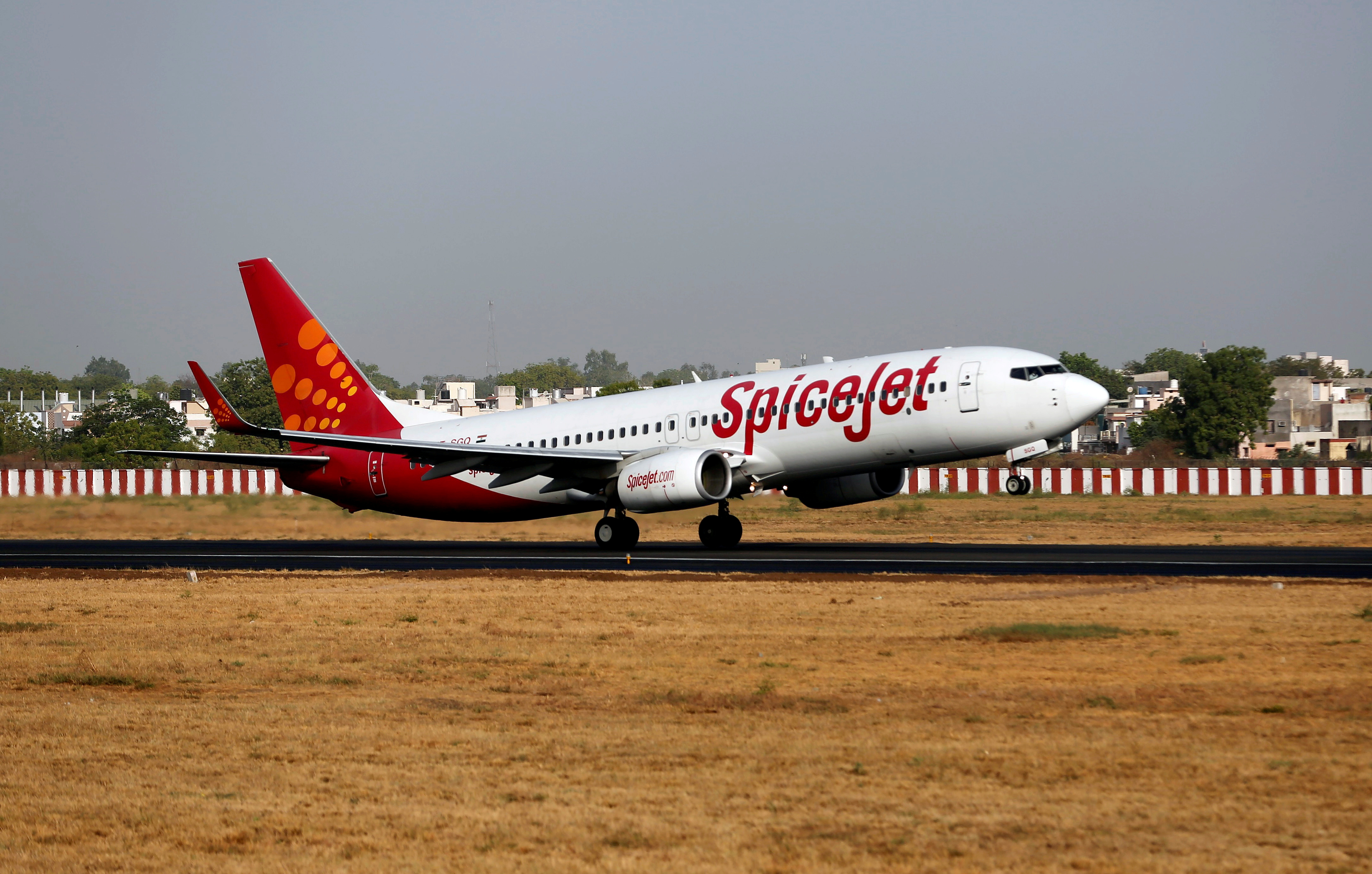 A SpiceJet passenger Boeing 737-800 aircraft takes off from Sardar Vallabhbhai Patel international airport in Ahmedabad, India May 19, 2016. REUTERS/Amit Dave