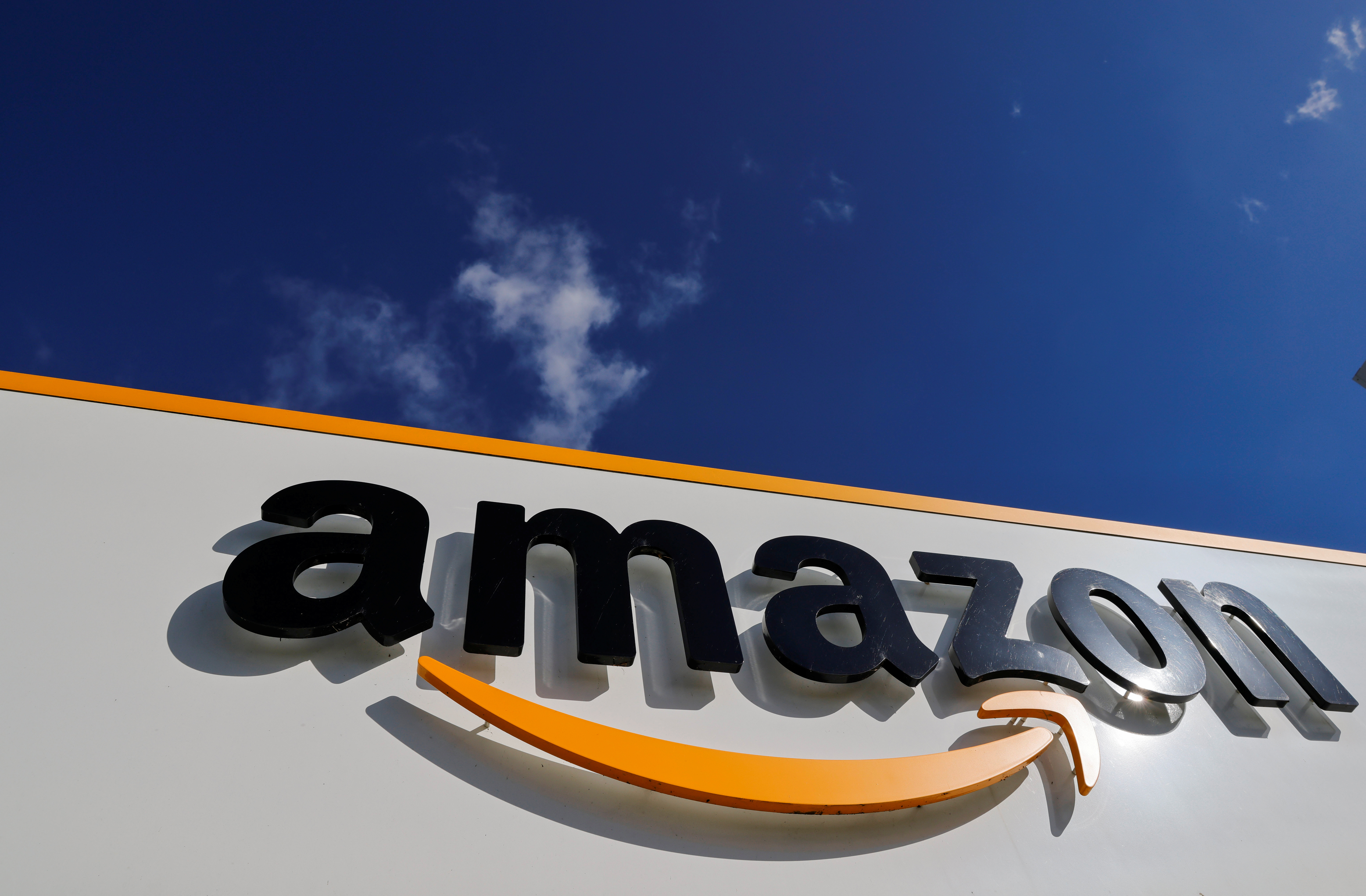 The logo of Amazon is seen at the company logistics centre in Boves, France. REUTERS/Pascal Rossignol