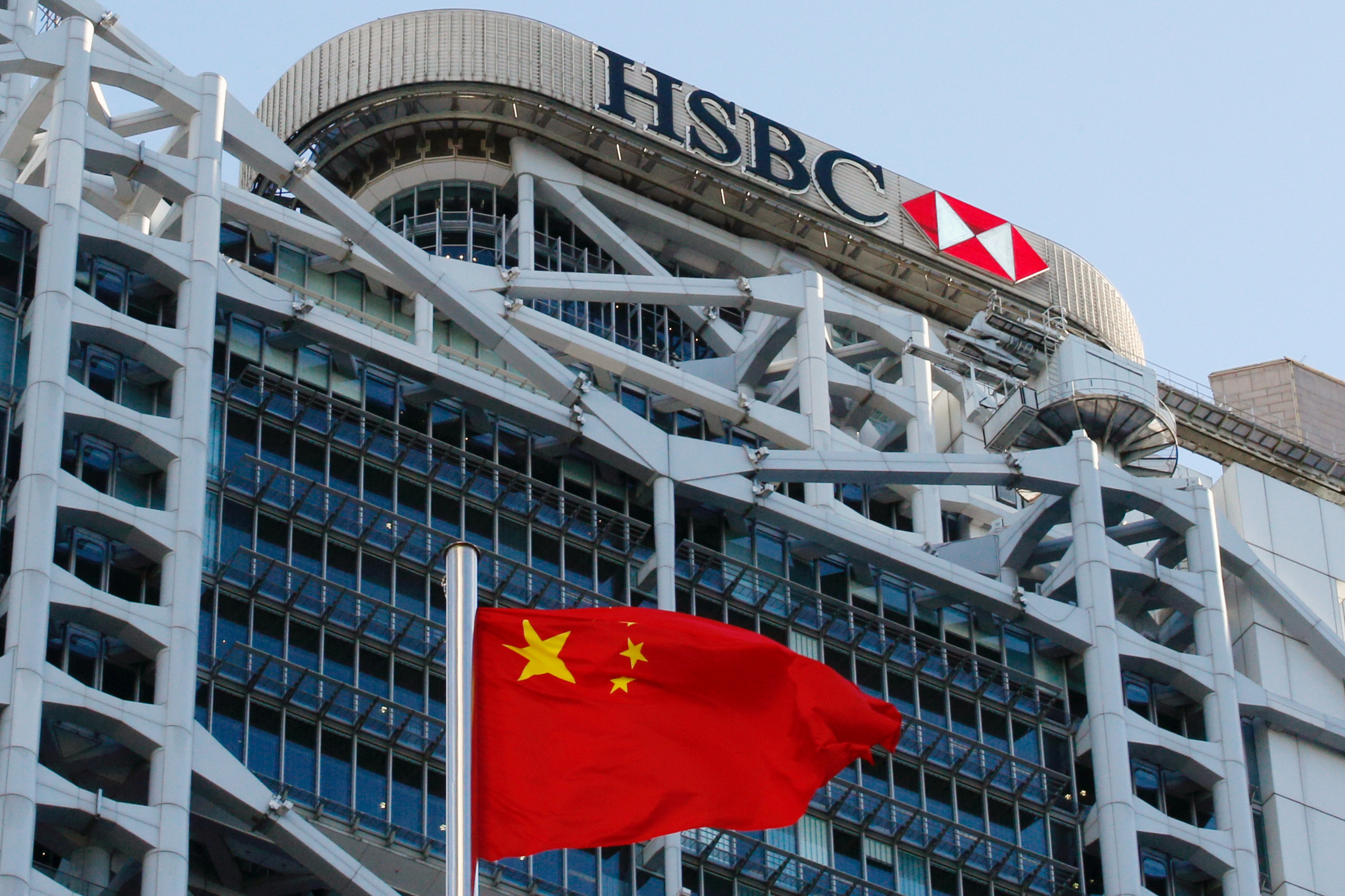 A Chinese national flag flies in front of HSBC headquarters in Hong Kong, China, July 28, 2020. REUTERS/Tyrone Siu