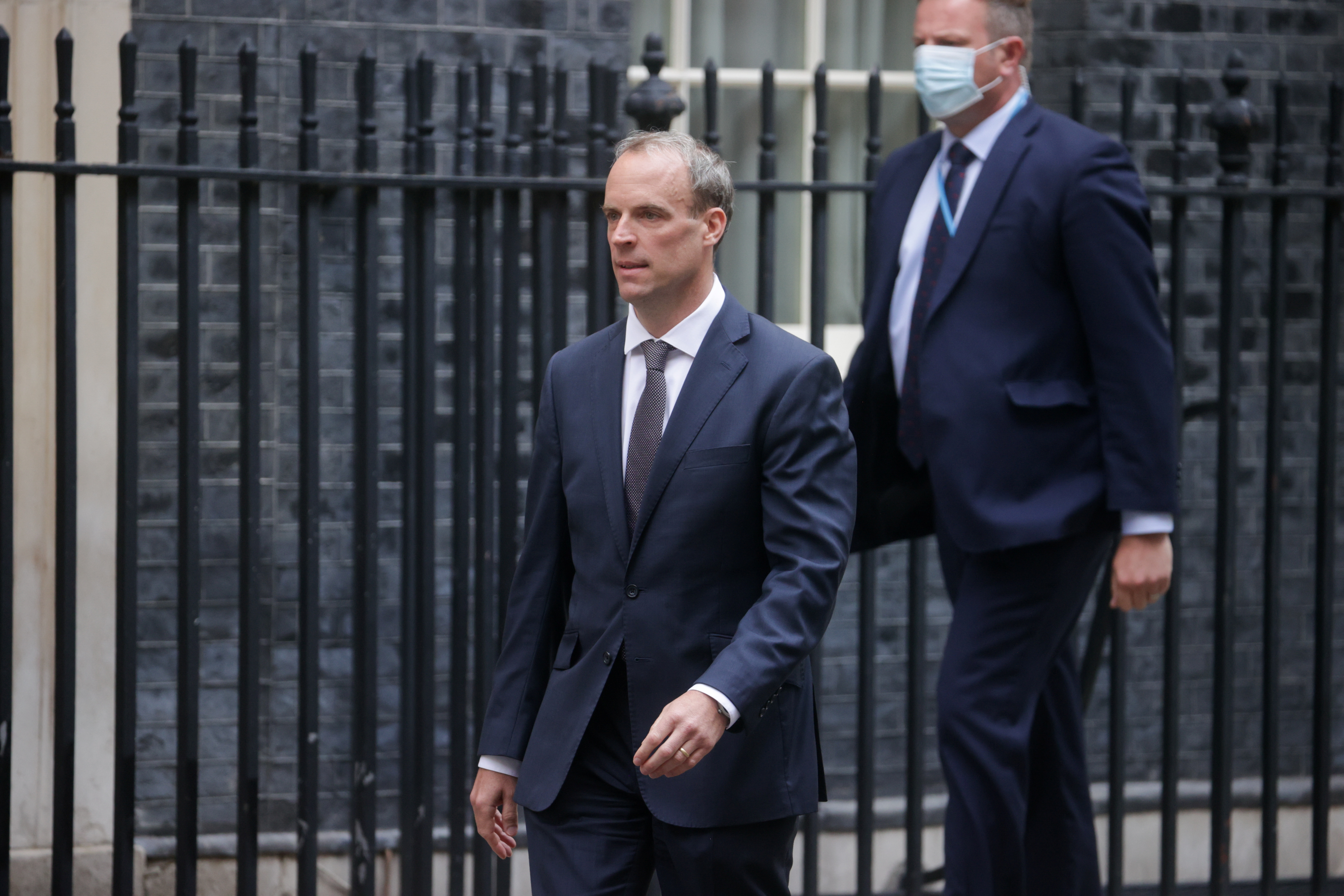 Britain's Foreign Secretary Dominic Raab walks outside Downing Street in London, Britain, August 19, 2021. REUTERS/Hannah McKay
