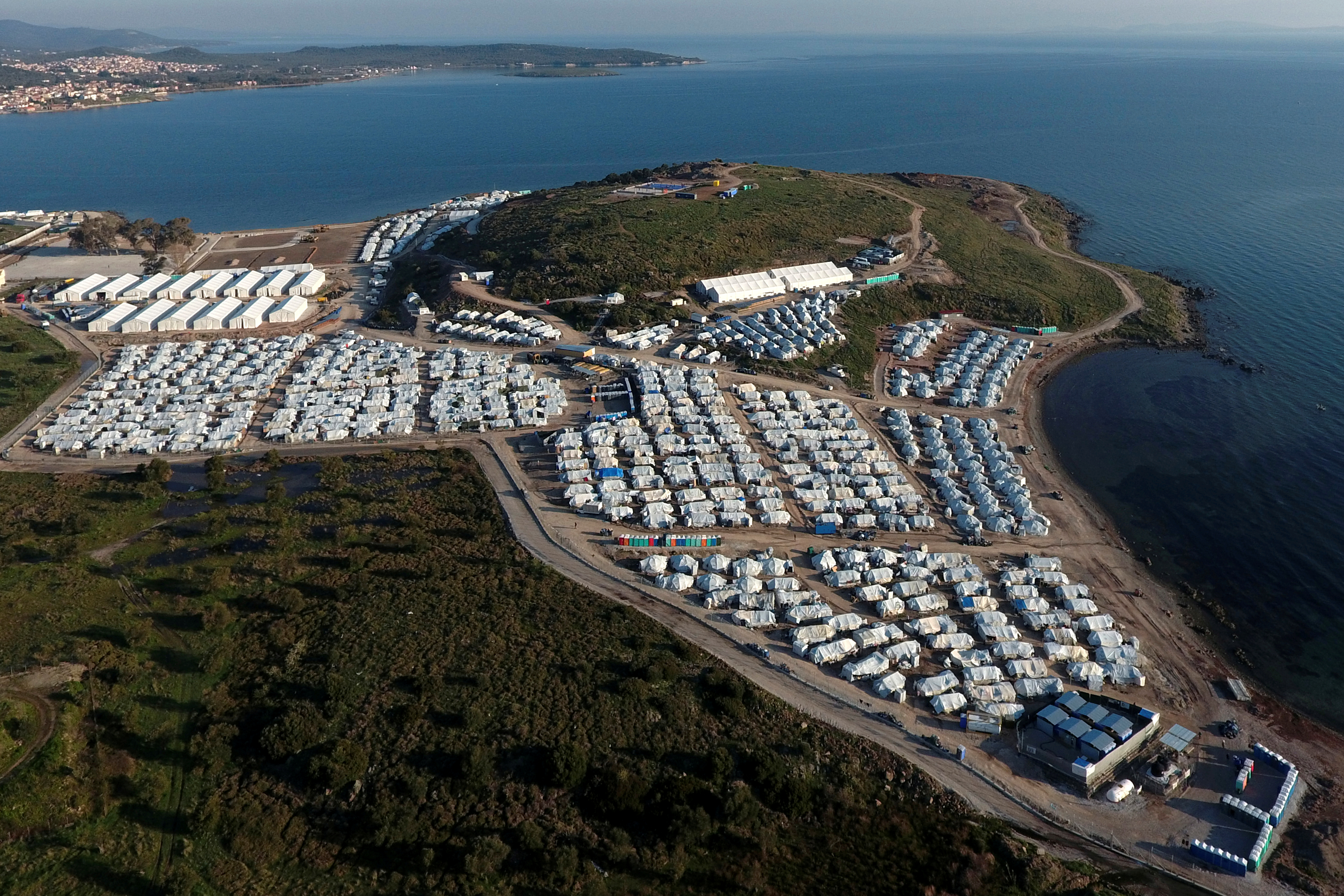 An aerial view of the Mavrovouni camp for refugees and migrants on the island of Lesbos, Greece, March 27, 2021. Picture taken with a drone. REUTERS/Giorgos Moutafis