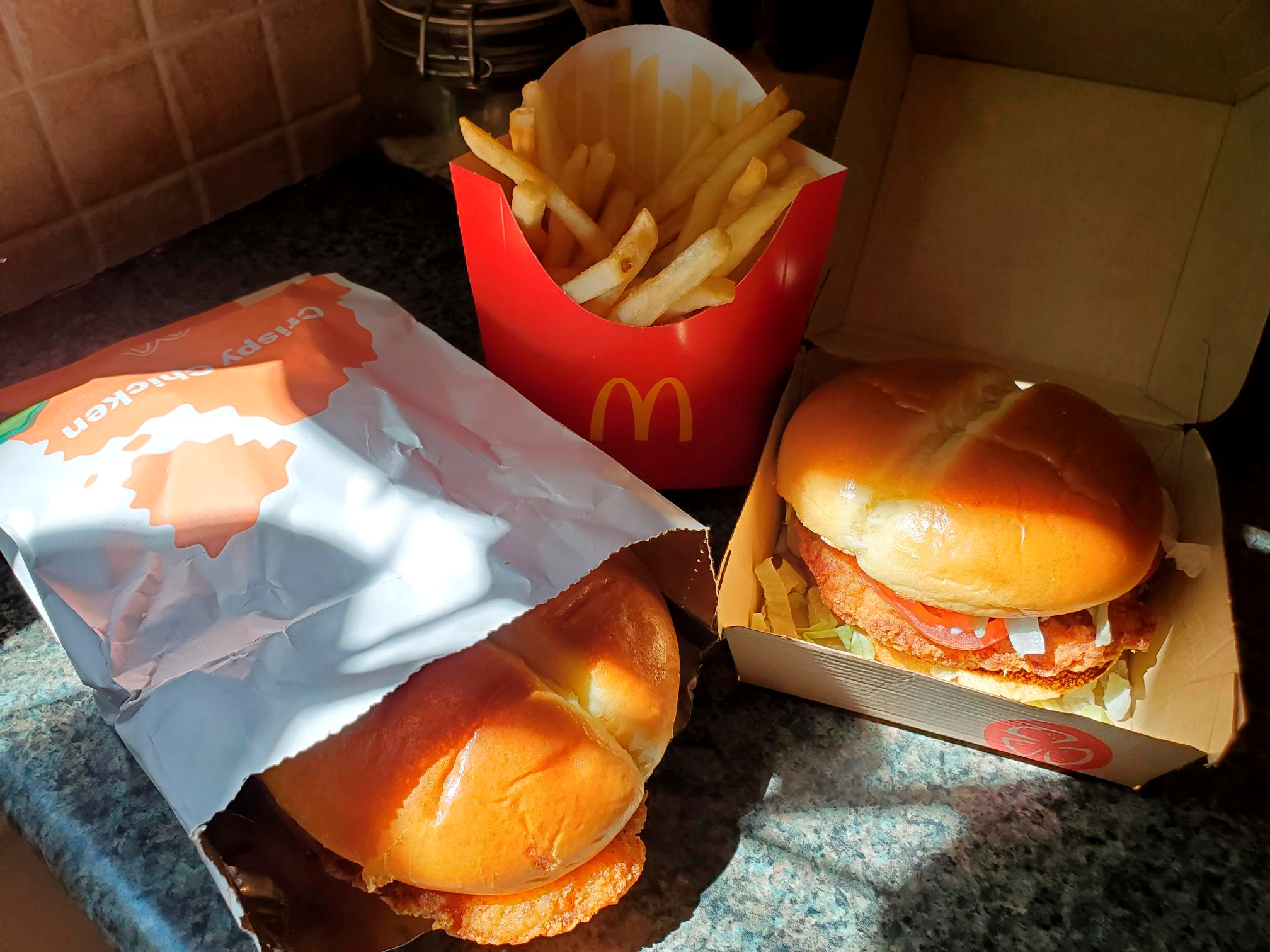 McDonald's Crispy Chicken Sandwiches and fries are pictured in New York, U.S. March 30, 2021. Picture taken March 30, 2021. REUTERS/Hilary Russ