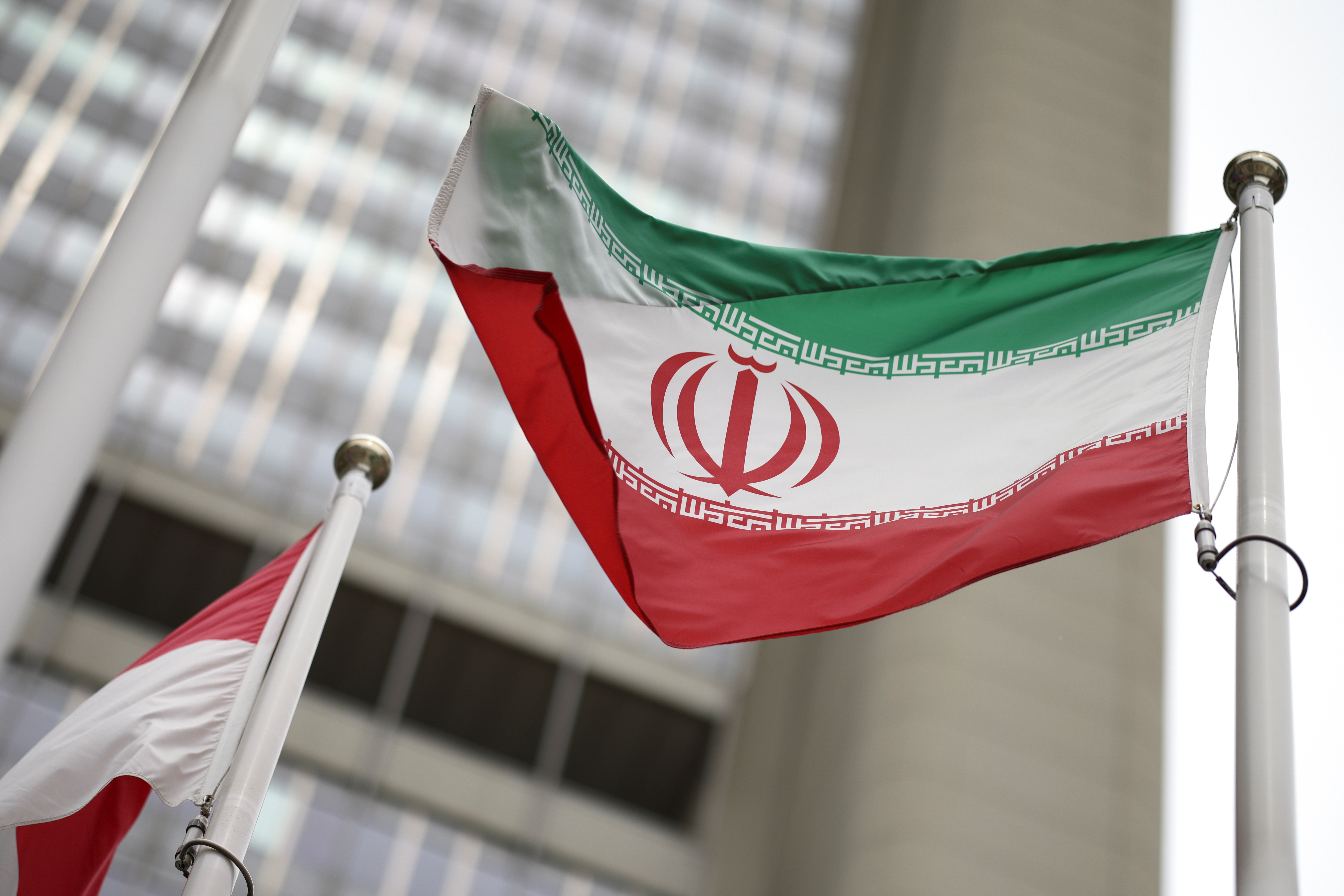 Iranian flag flies in front of the UN office building, housing IAEA headquarters, amid the coronavirus disease (COVID-19) pandemic, in Vienna, Austria, May 24, 2021. REUTERS/Lisi Niesner