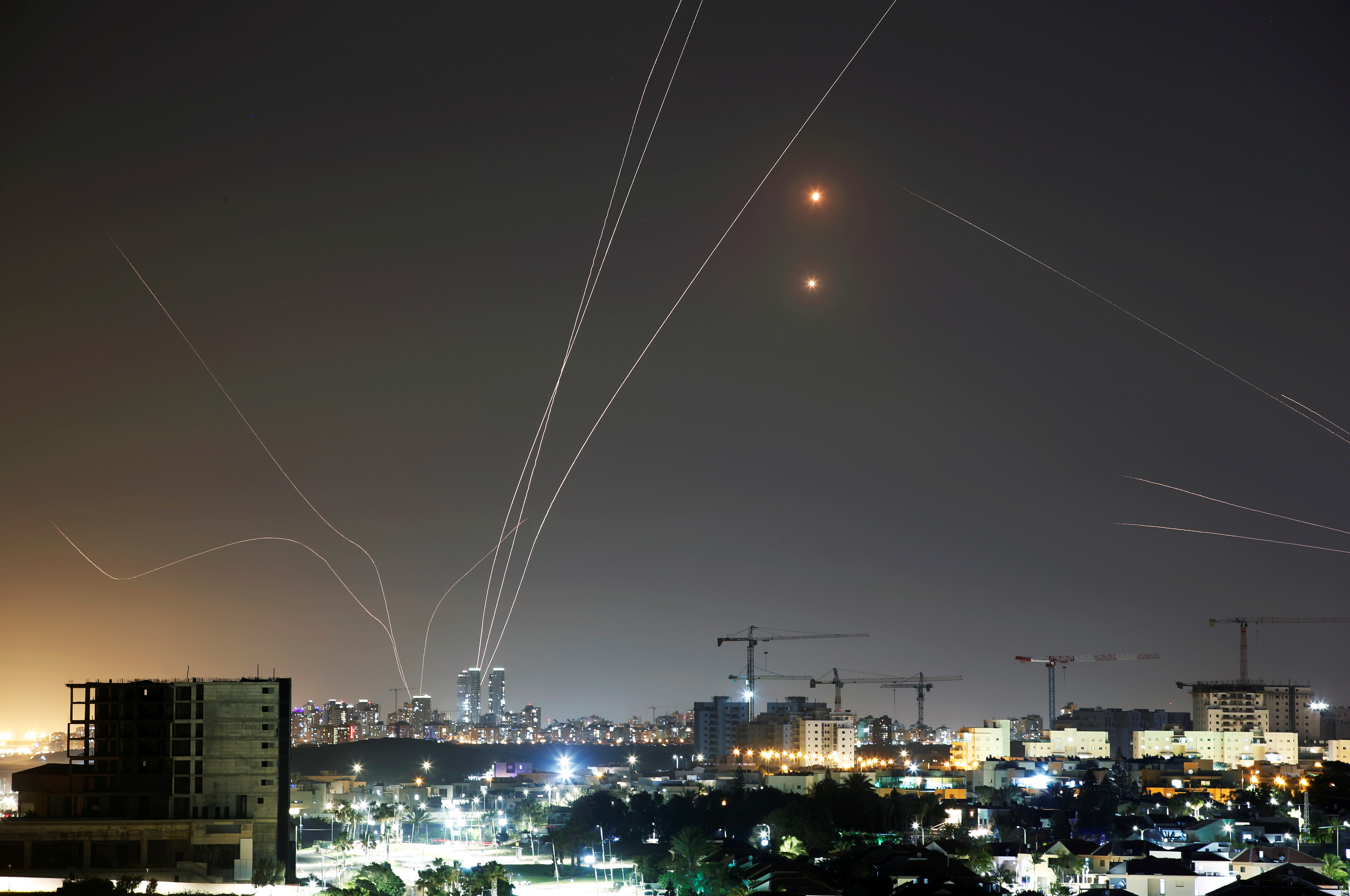Streaks of light are seen as Israel's Iron Dome anti-missile system intercepts rockets launched from the Gaza Strip towards Israel, as seen from Ashkelon, Israel May 11, 2021. REUTERS/Amir Cohen