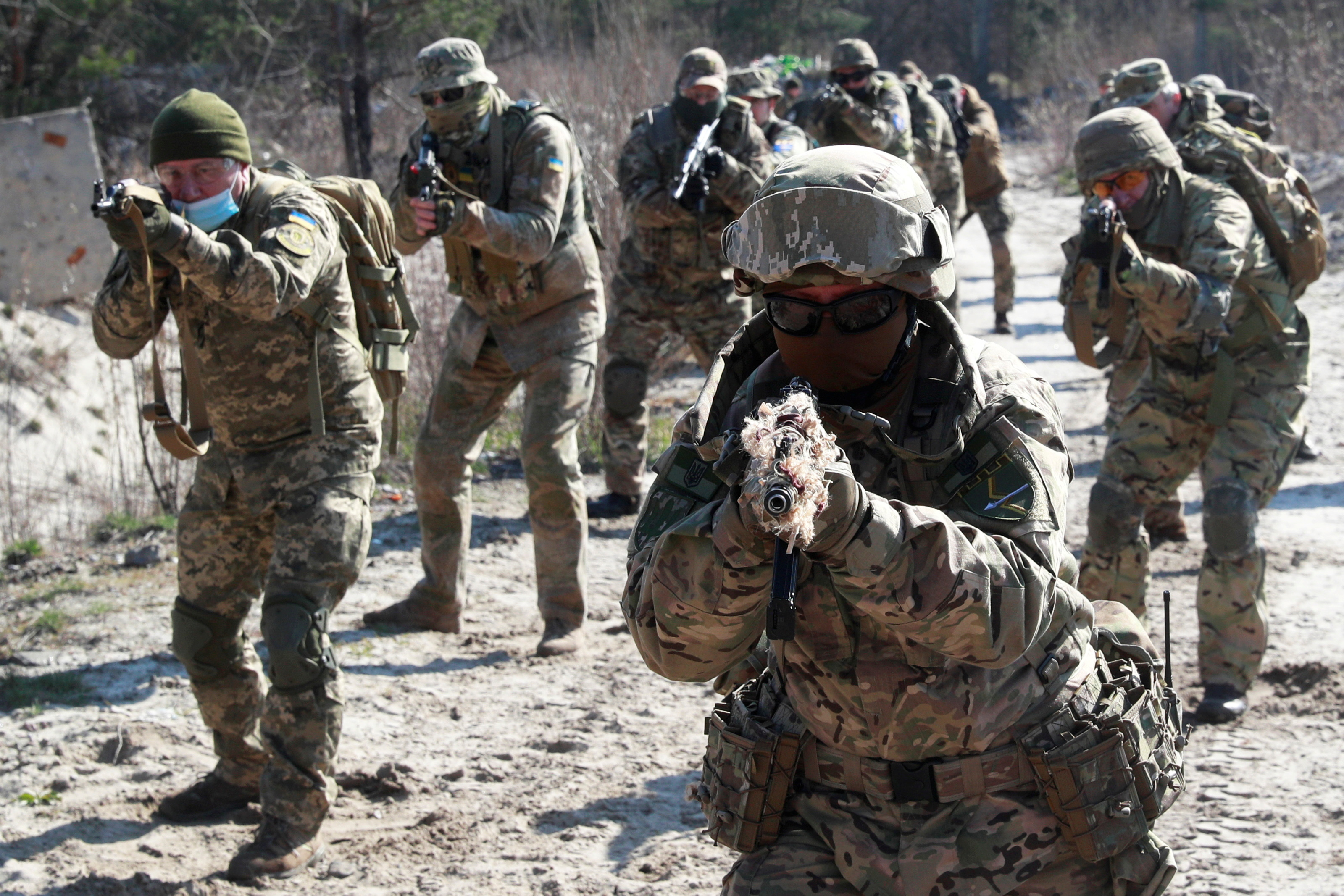 Reservists of the 130th battalion of the Ukrainian Territorial Defence Forces attend military exercises on outskirts of Kyiv, Ukraine April 10, 2021. REUTERS/Valentyn Ogirenko
