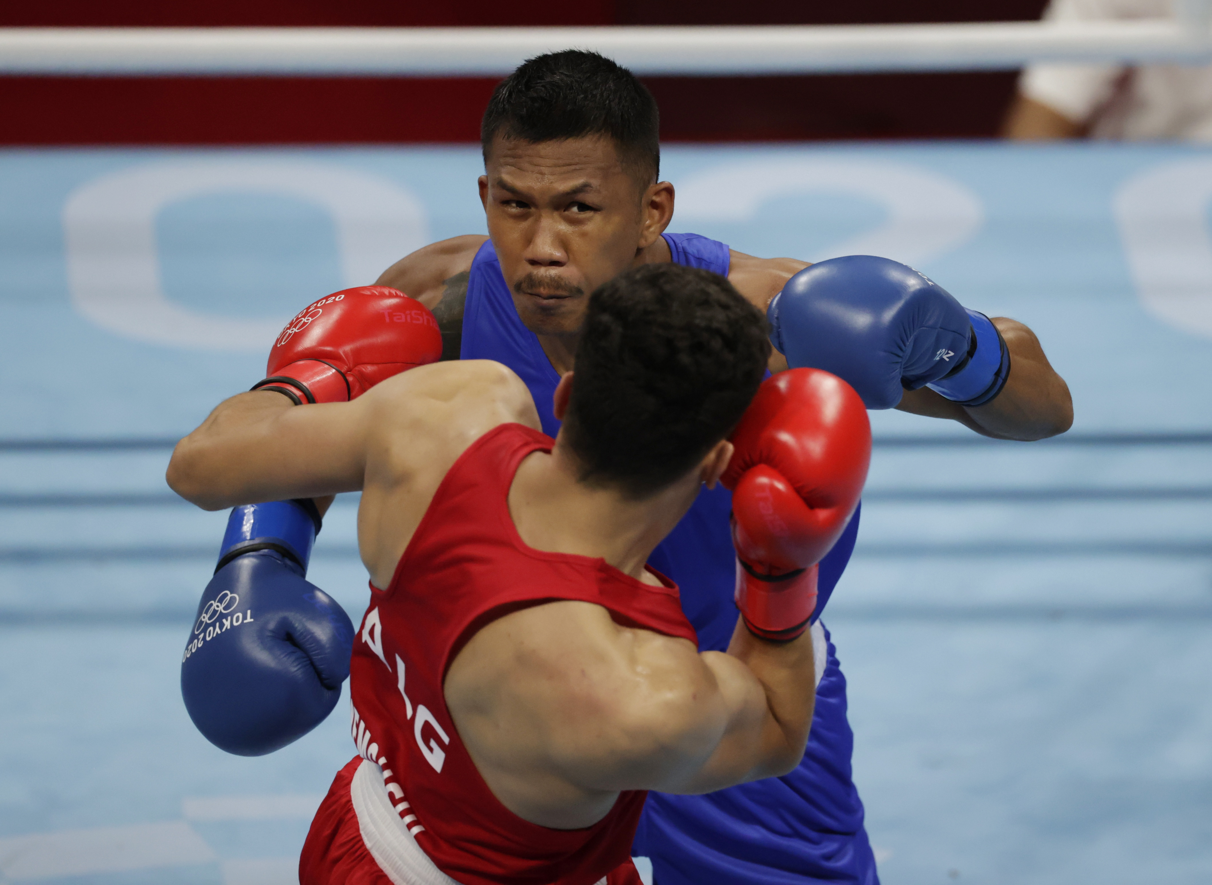 Tokyo 2020 Olympics - Boxing - Men's Middleweight - Last 16  - Kokugikan Arena - Tokyo, Japan - July 29, 2021. Younes Nemouchi of Algeria and Eumir Marcial of the Philippines in action. REUTERS/Ueslei Marcelino