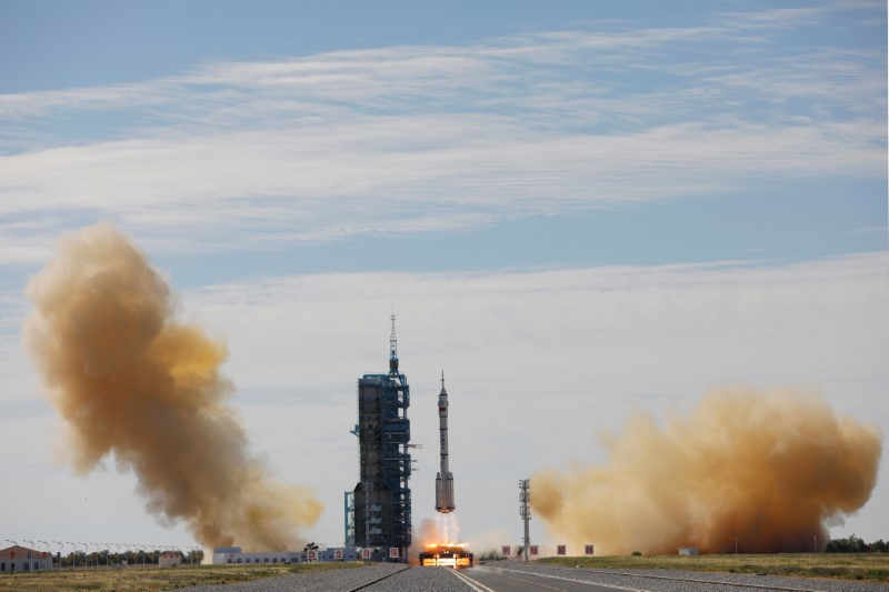 The Long March-2F Y12 rocket, carrying the Shenzhou-12 spacecraft and three astronauts, takes off from Jiuquan Satellite Launch Center for China's first manned mission to build its space station, near Jiuquan, Gansu province, China June 17, 2021.   REUTERS/Carlos Garcia Rawlins