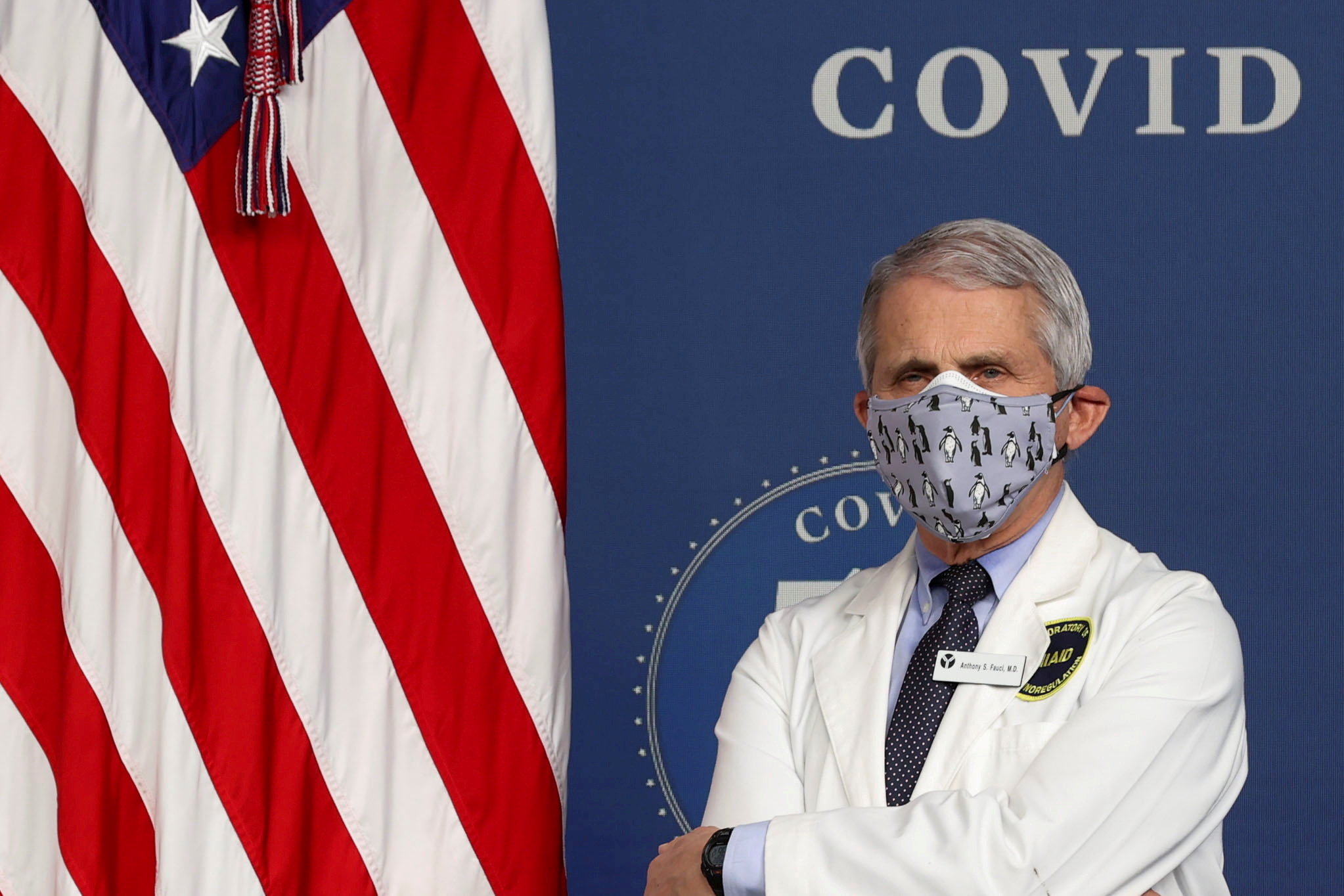 National Institute of Allergy and Infectious Diseases Director Dr. Anthony Fauci  stands by during an event to commemorate the 50 millionth coronavirus disease (COVID-19) vaccination in the South Court Auditorium at the White House in Washington, U.S., February 25, 2021. REUTERS/Jonathan Ernst/File Photo