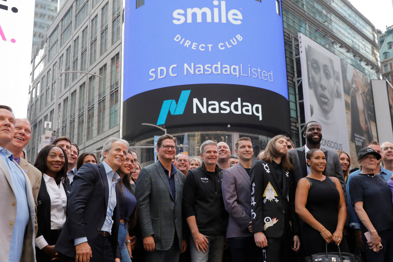 SmileDirectClub celebrates as the company debuts its IPO outside the Nasdaq MarketSite in New York, U.S. September 12, 2019. REUTERS/Lucas Jackson