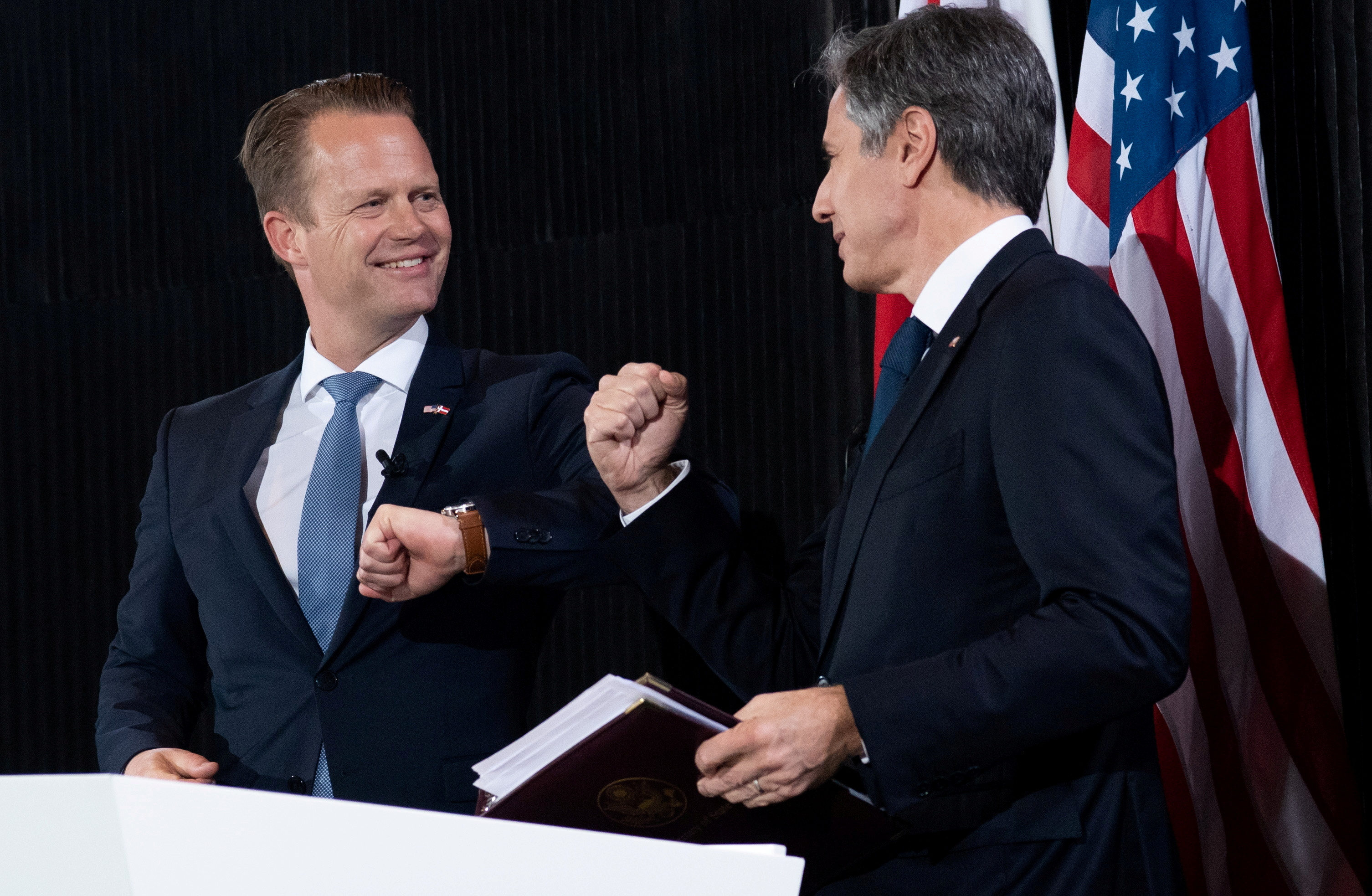 U.S. Secretary of State Antony Blinken and Danish Foreign Minister Jeppe Kofod elbow bump at the end of a joint news conference following meetings at the Danish Foreign Ministry in Copenhagen, Denmark, May 17, 2021. Saul Loeb/Pool via REUTERS/File Photo