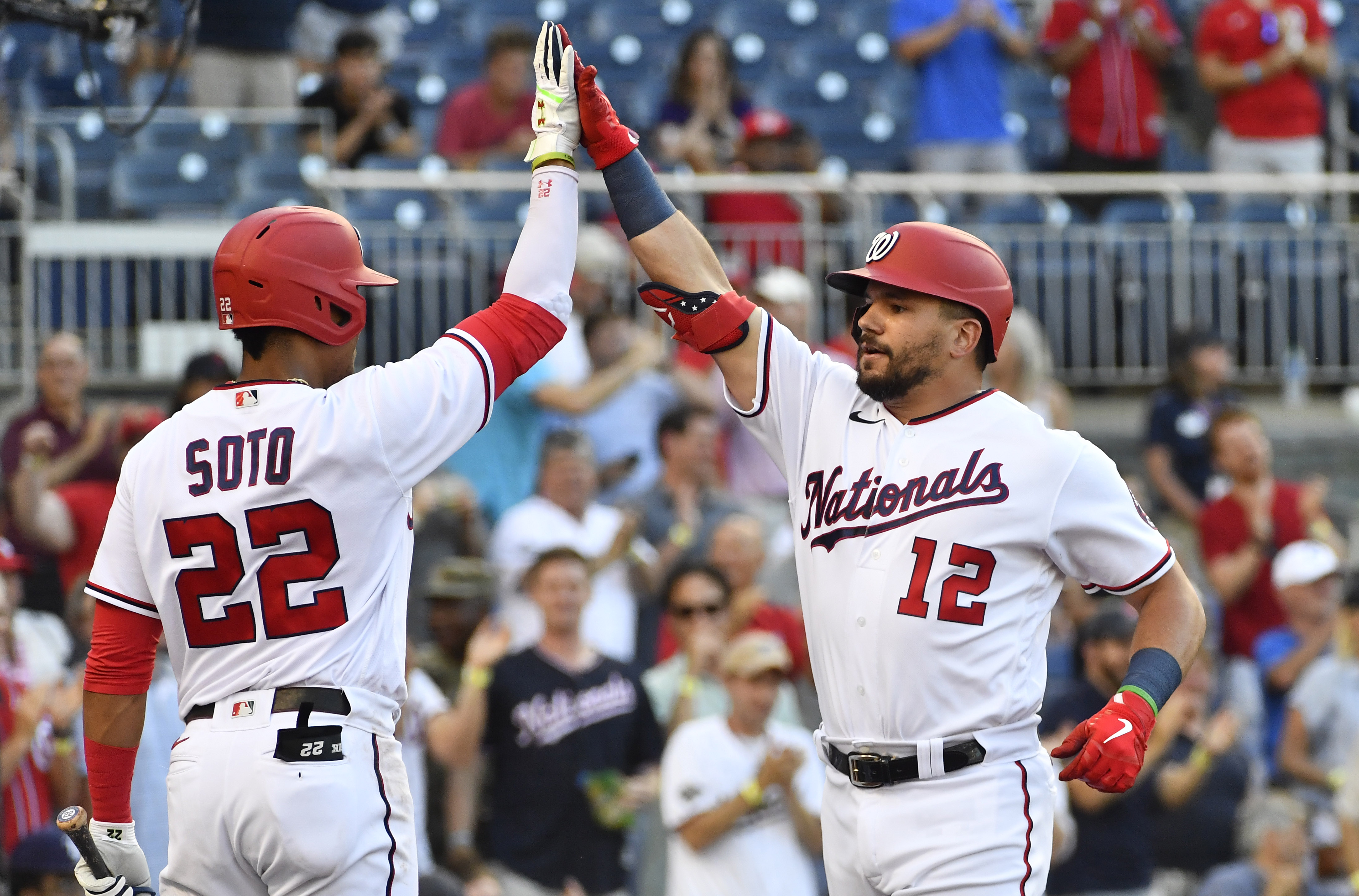 Jun 29, 2021; Washington, District of Columbia, USA; Washington Nationals left fielder Kyle Schwarber (12) is congratulated by left fielder Juan Soto (22) after hitting a solo home run during the first inning at Nationals Park. Brad Mills-USA TODAY Sports
