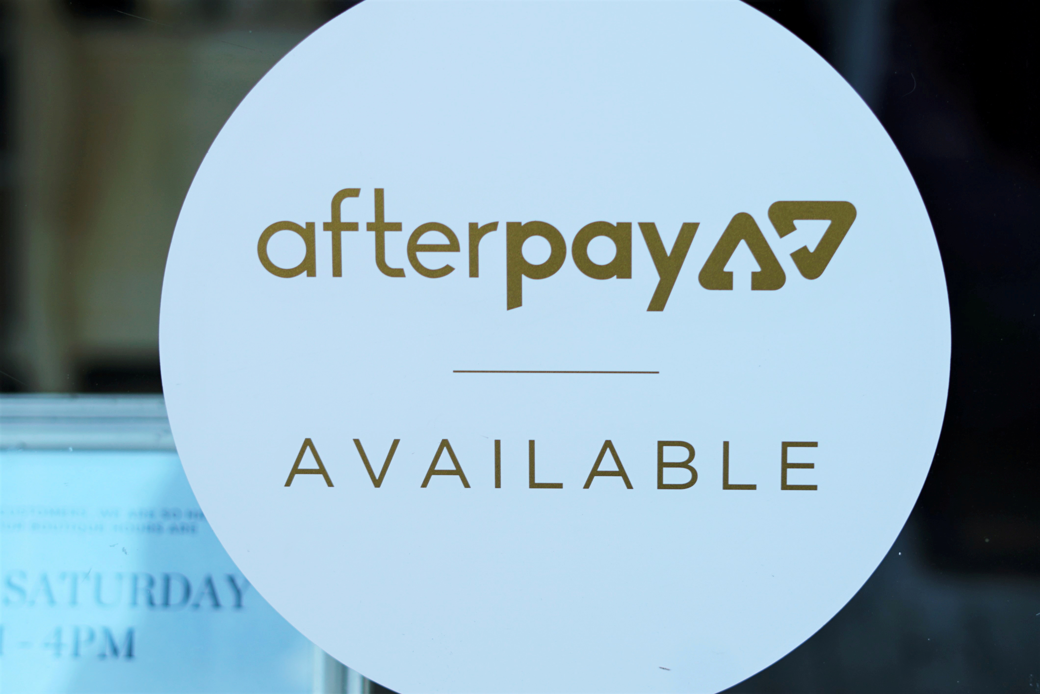 A logo for the company Afterpay is seen in a store window in Sydney, Australia, July 9, 2020.  REUTERS/Stephen Coates/File Photo