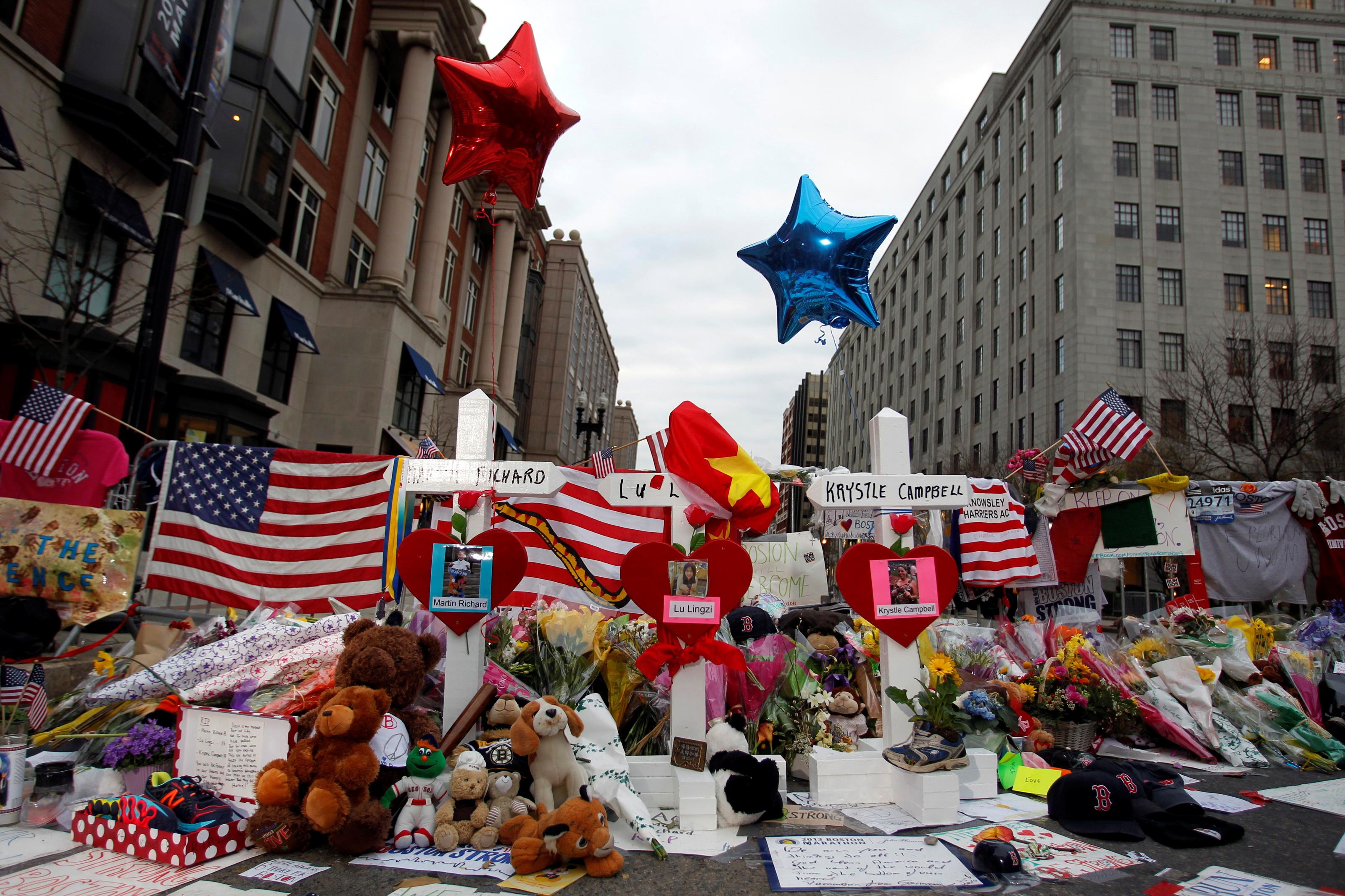 Three crosses for each of the three people killed in the Boston Marathon bombings at a makeshift memorial on Boylston Street in Boston, Massachusetts, April 18, 2013. REUTERS/Jessica Rinaldi