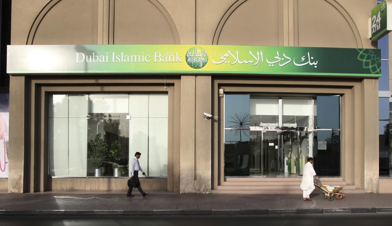 People walk past a branch of Dubai Islamic Bank on Baniyas Road in Dubai February 6, 2012. REUTERS/Nikhil Monteiro