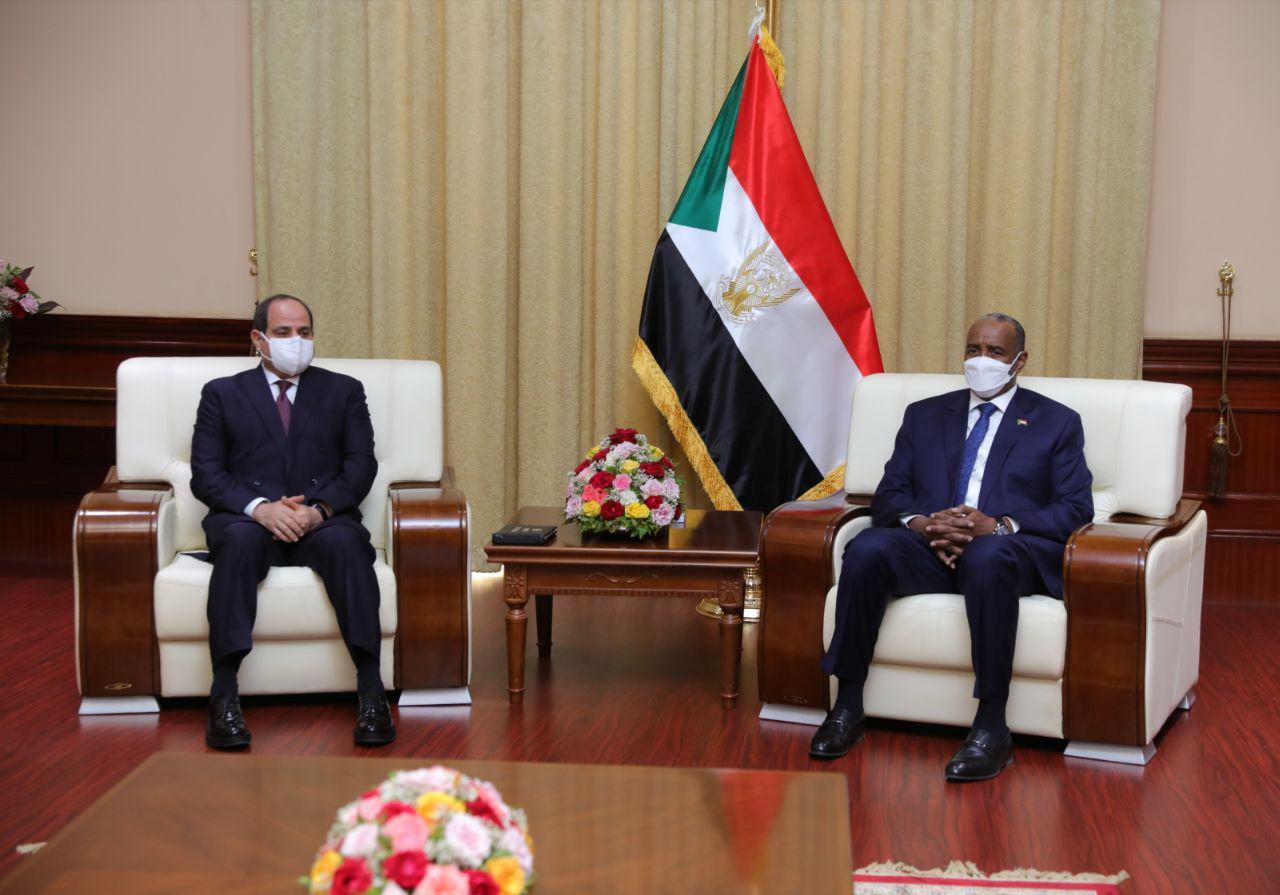 Sudan's Sovereign Council Chief General Abdel Fattah al-Burhan meets with Egyptian President Abdel Fatah al-Sisi, in Khartoum, Sudan March 6, 2021. Sudan Sovereign Council/Handout via REUTERS