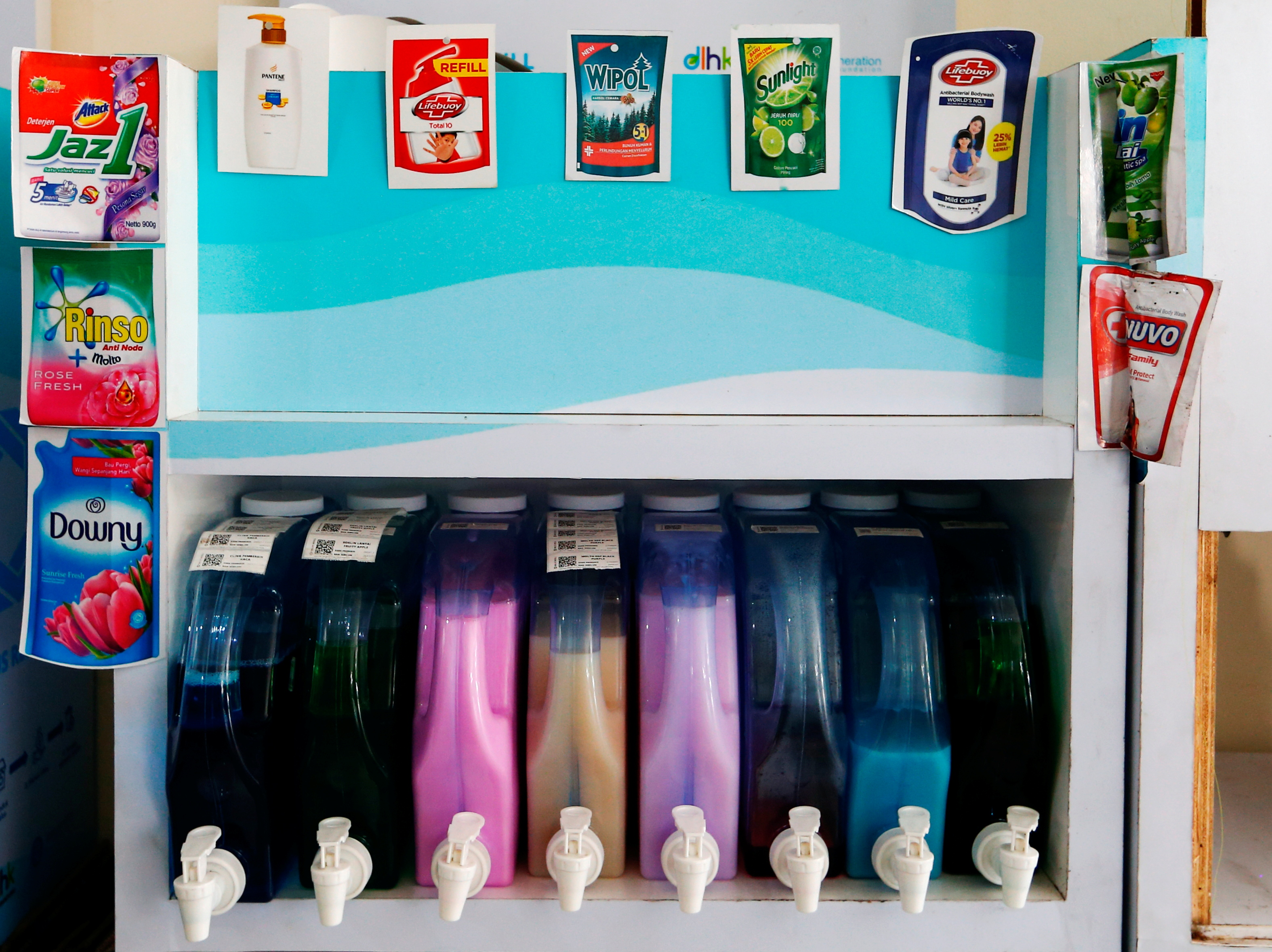 Dispensers containing cleaning liquids are seen at a Siklus office, a start-up company which refills household products in a bid to reduce plastic waste, in Jakarta, Indonesia, May 19, 2021. Picture taken May 19, 2021 REUTERS/Ajeng Dinar Ulfiana