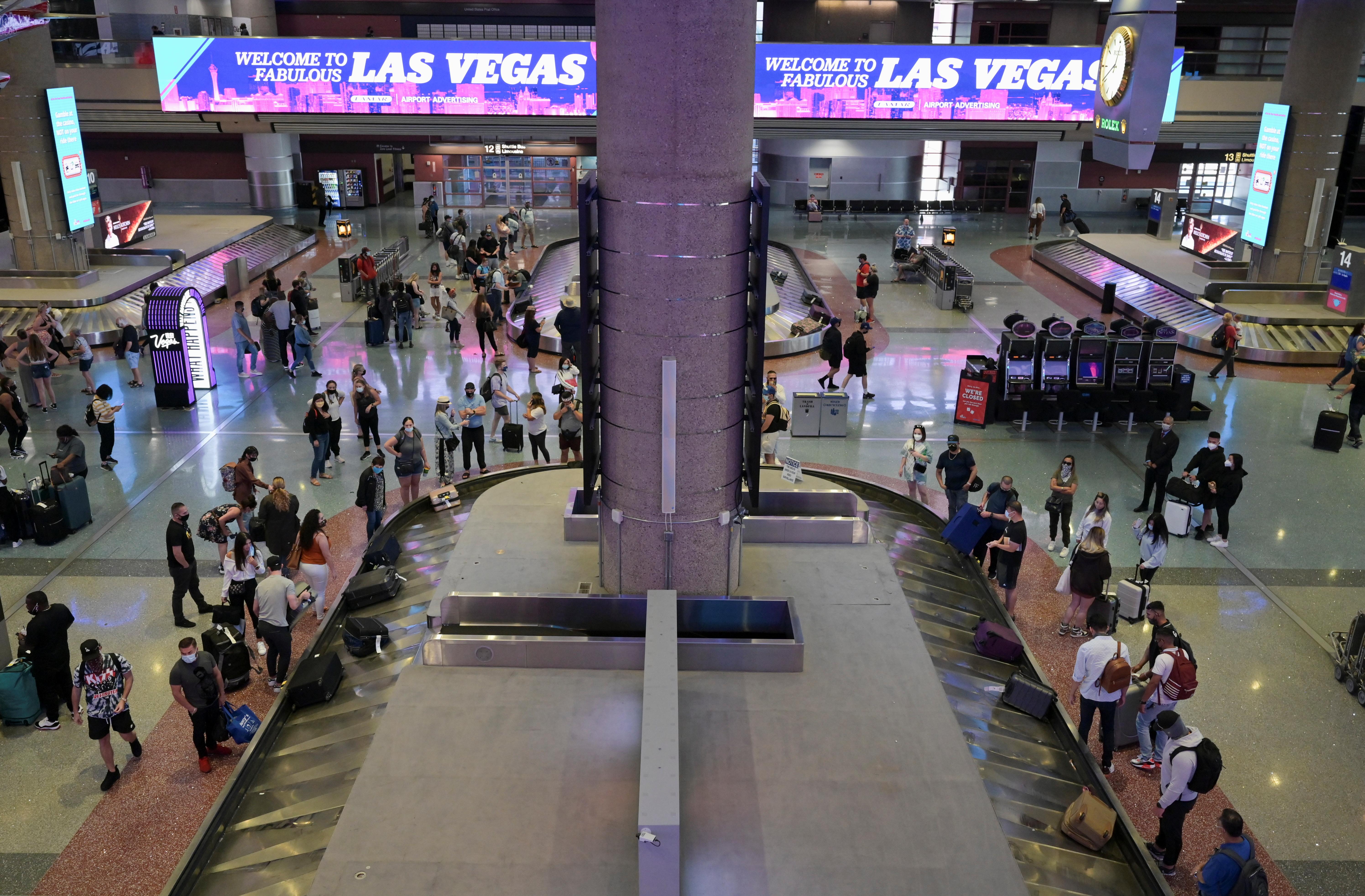 Travelers wait for luggage as they flock to Las Vegas ahead of Memorial Day weekend at McCarran International Airport in Las Vegas, Nevada, U.S., May 28, 2021.  REUTERS/Bridget Bennett