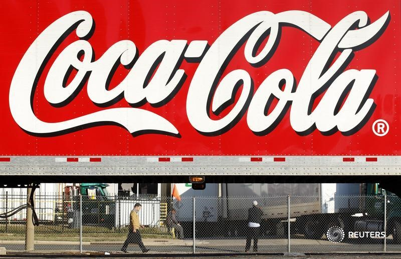 A man walks past a Coca-Cola truck at a distribution center in Alexandria, Virginia.  REUTERS/Kevin Lamarque