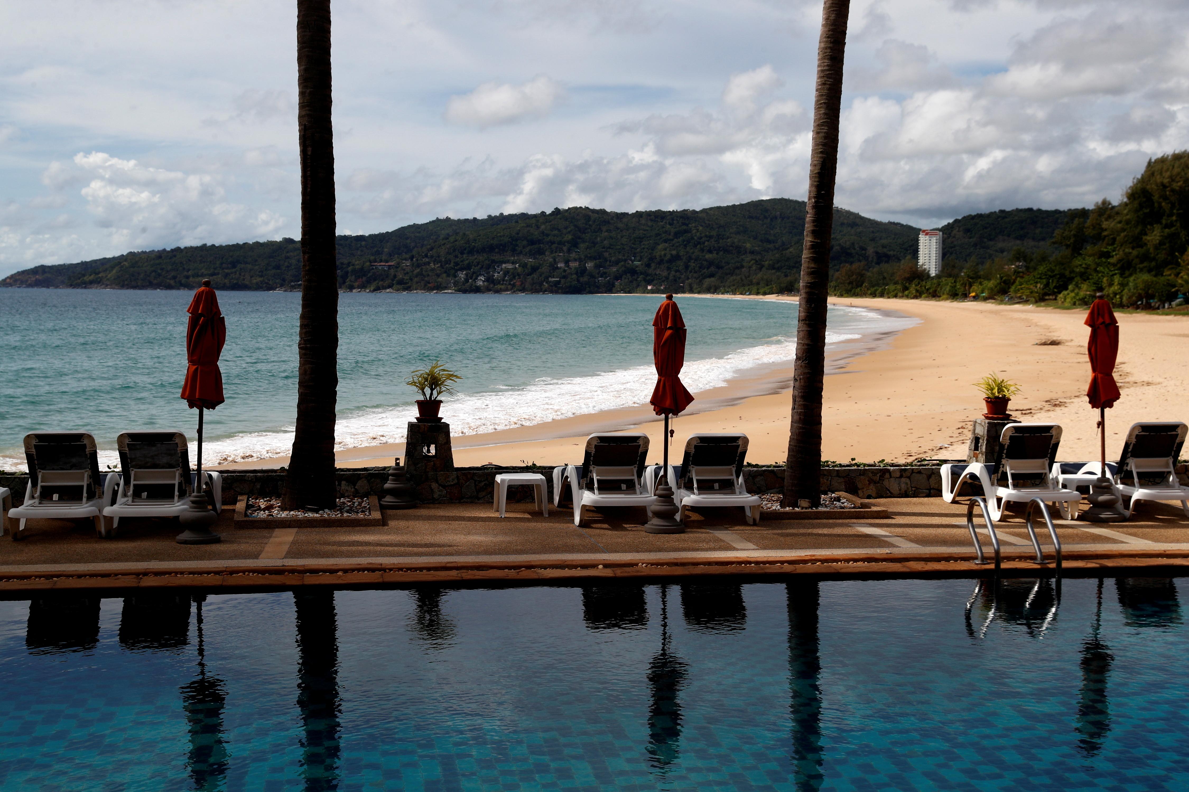 An empty hotel and beach which have opened for visitors is seen in Karon, Phuket Island, Thailand March 31, 2021. Picture taken March 31, 2021. REUTERS/Jorge Silva/File Photo