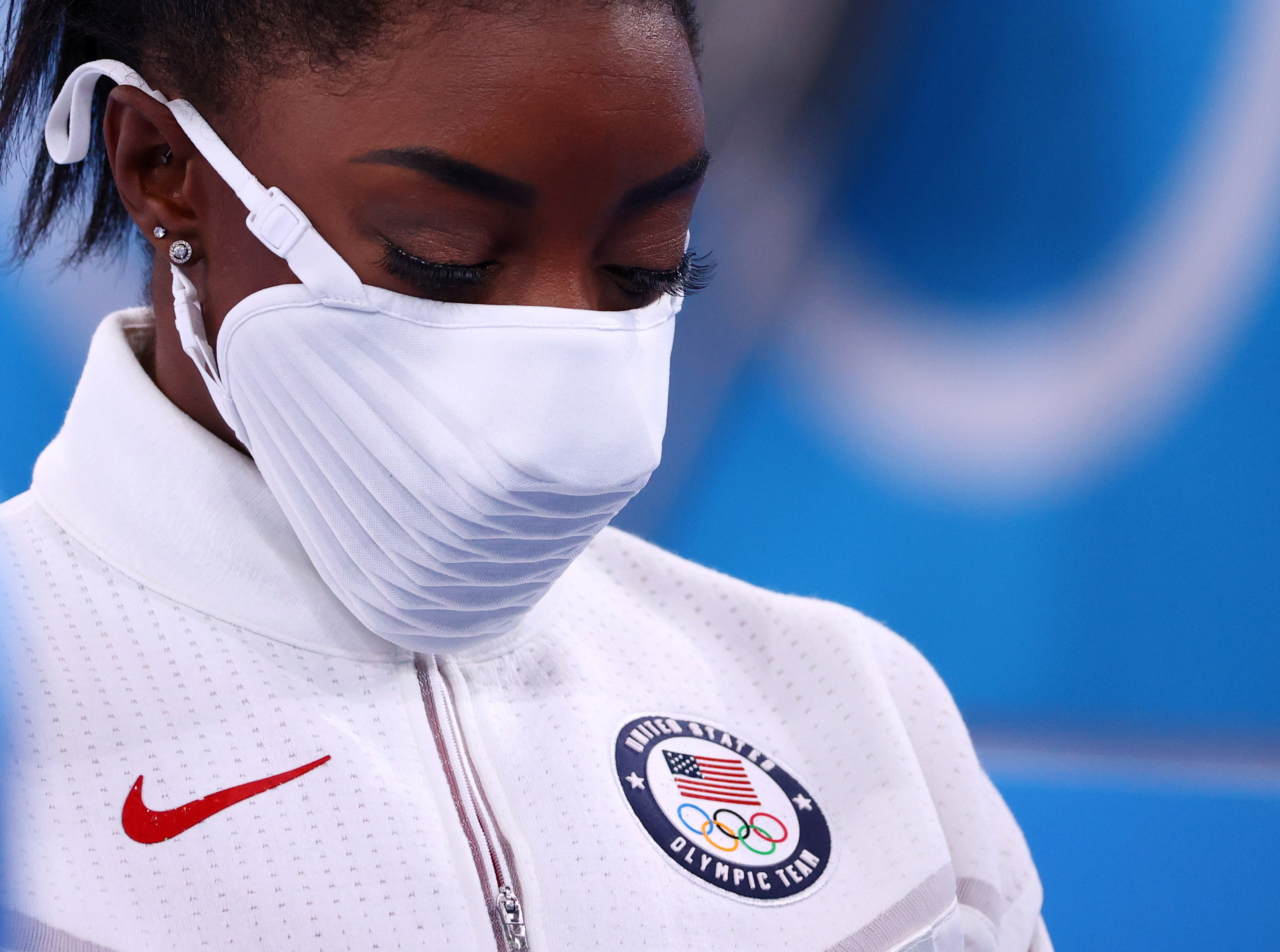 Tokyo 2020 Olympics - Gymnastics - Artistic - Women's Team - Final - Ariake Gymnastics Centre, Tokyo, Japan - July 27, 2021.  Silver medallist Simone Biles of the United States wearing a protective face mask looks down. REUTERS/Lindsey Wasson