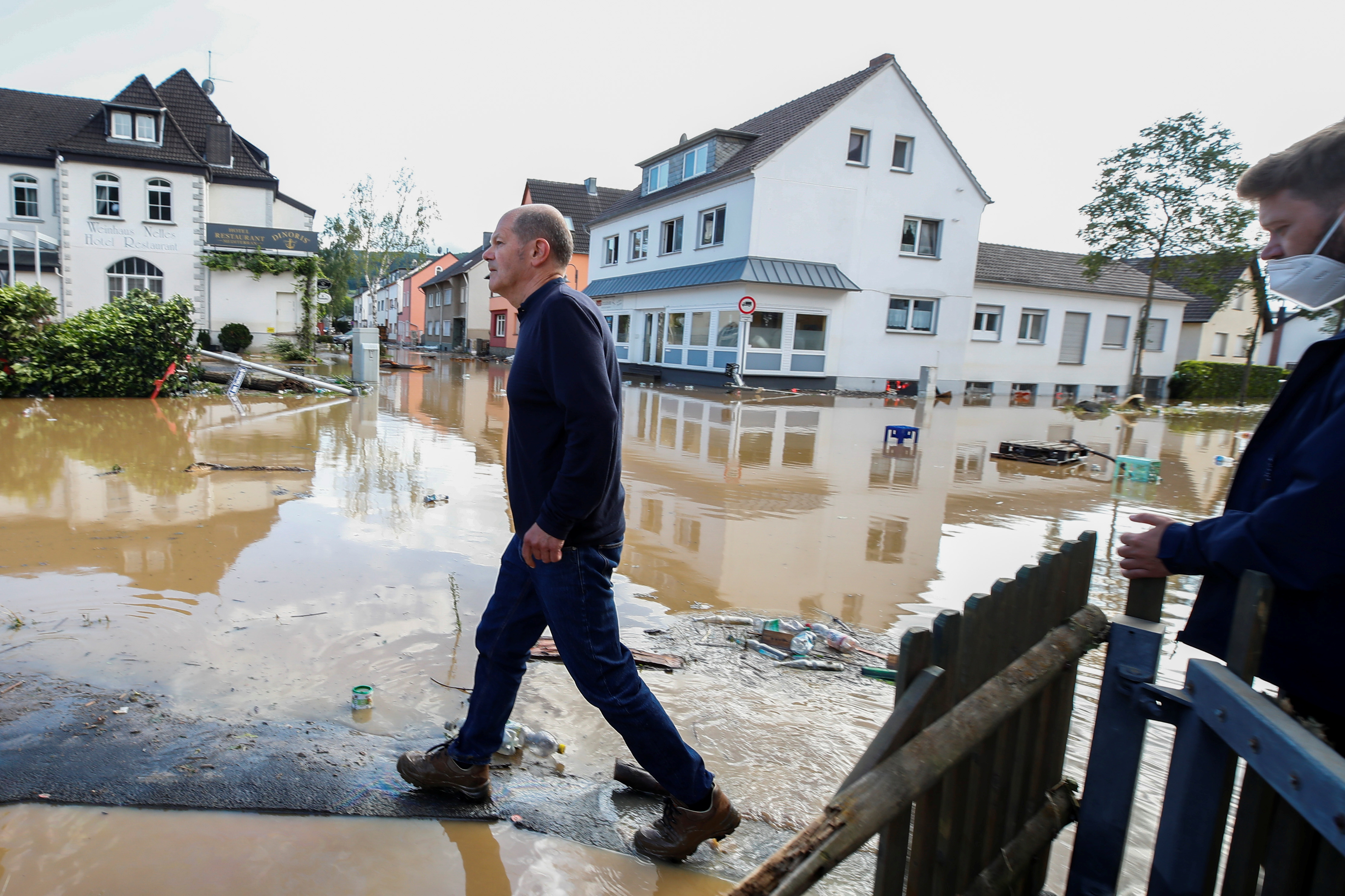 German Finance Minister Olaf Scholz visits a damaged area following heavy rainfalls in Bad Neuenahr-Ahrweiler, Germany, July 15, 2021. REUTERS/Wolfgang Rattay