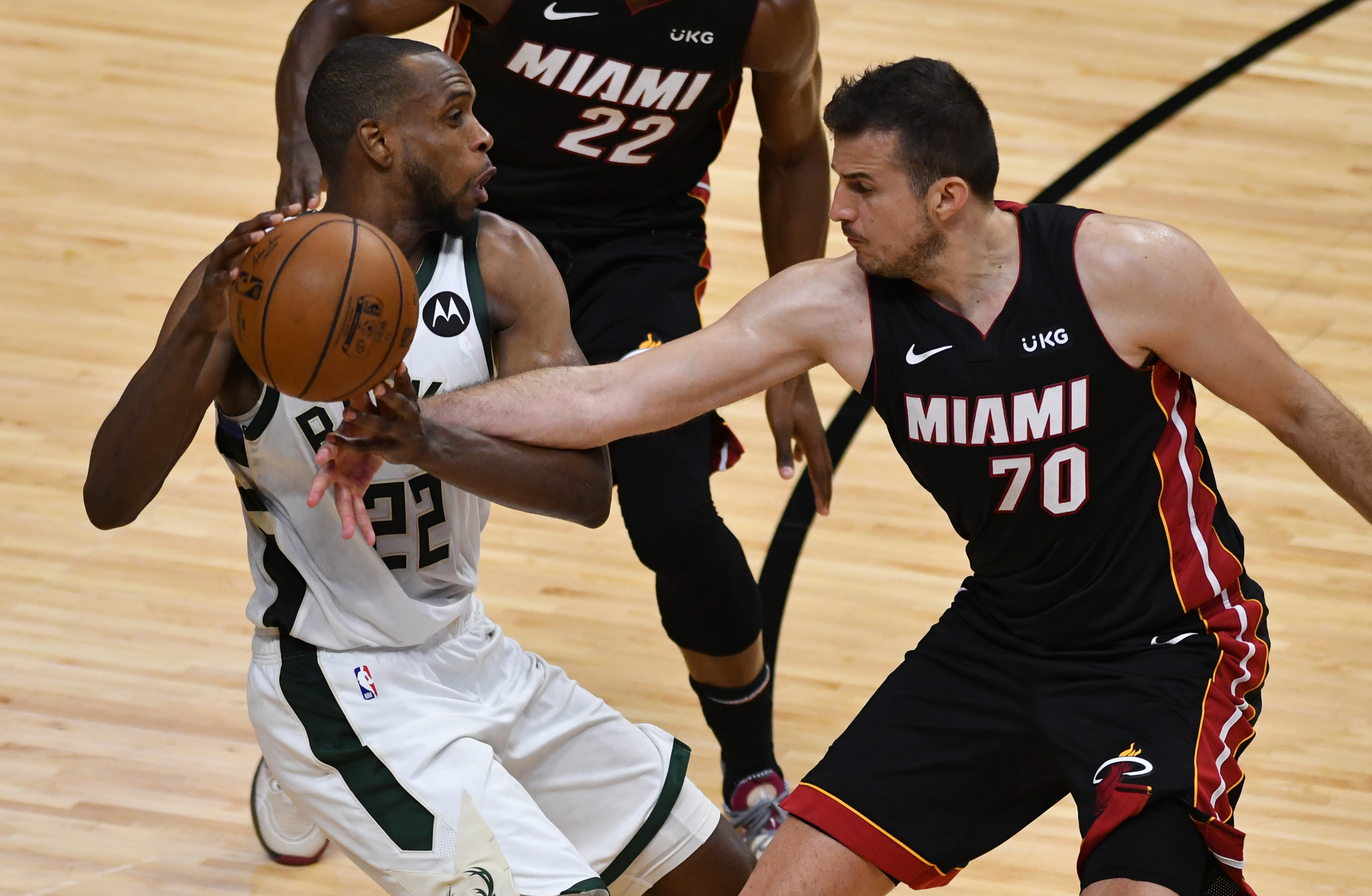 May 27, 2021; Miami, Florida, USA; Miami Heat forward Nemanja Bjelica (70) tips the ball loose from Milwaukee Bucks forward Khris Middleton (22) in the second half during game three in the first round of the 2021 NBA Playoffs at American Airlines Arena. Mandatory Credit: Jim Rassol-USA TODAY Sports