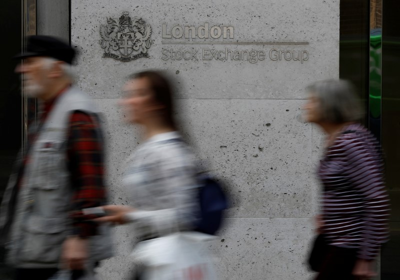 People walk past the entrance of the London Stock Exchange in London, Britain. Aug 23, 2018. REUTERS/Peter Nicholls/File photo