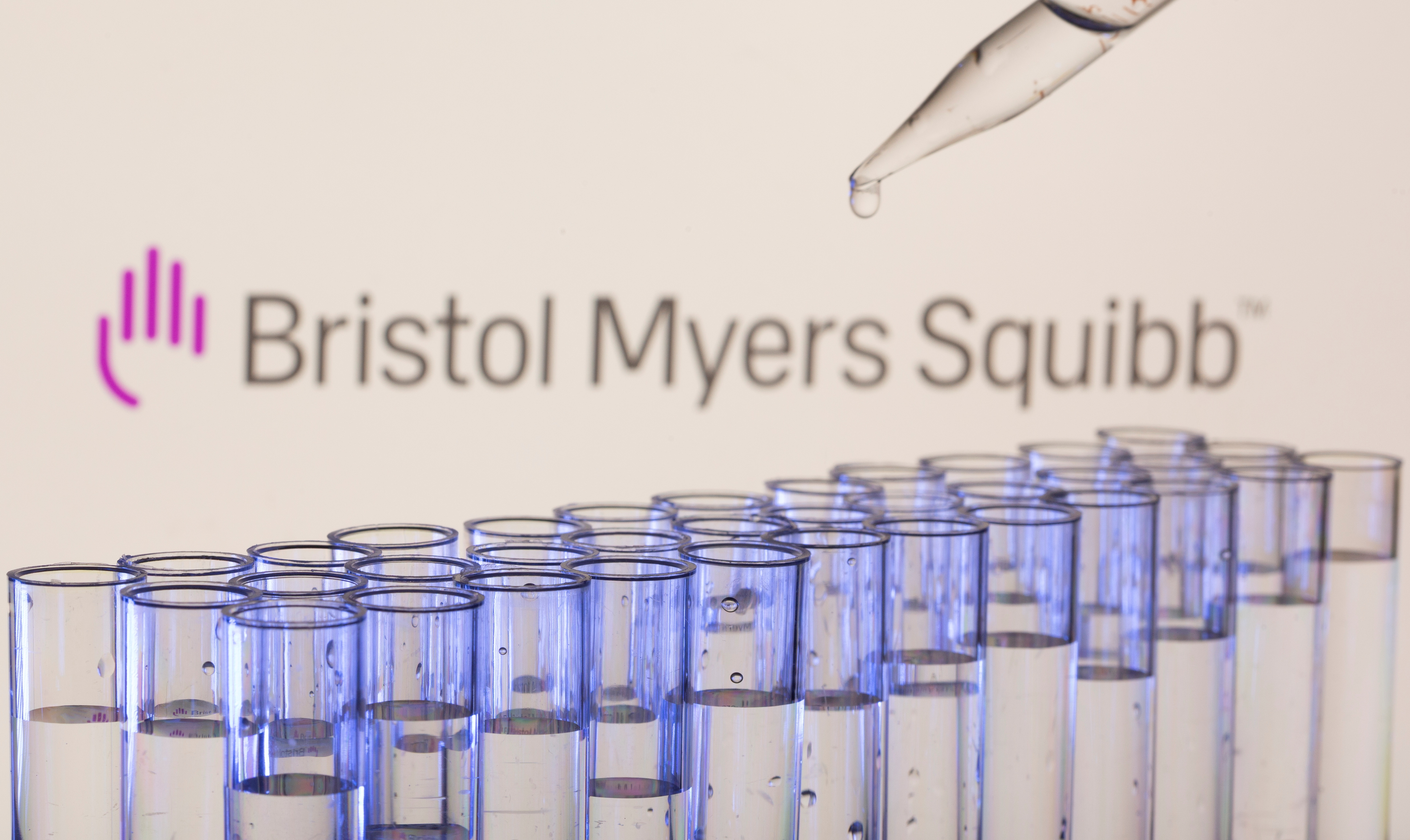 Test tubes are seen in front of a displayed Bristol Myers Squibb logo in this illustration taken, May 21, 2021. REUTERS/Dado Ruvic/Illustration