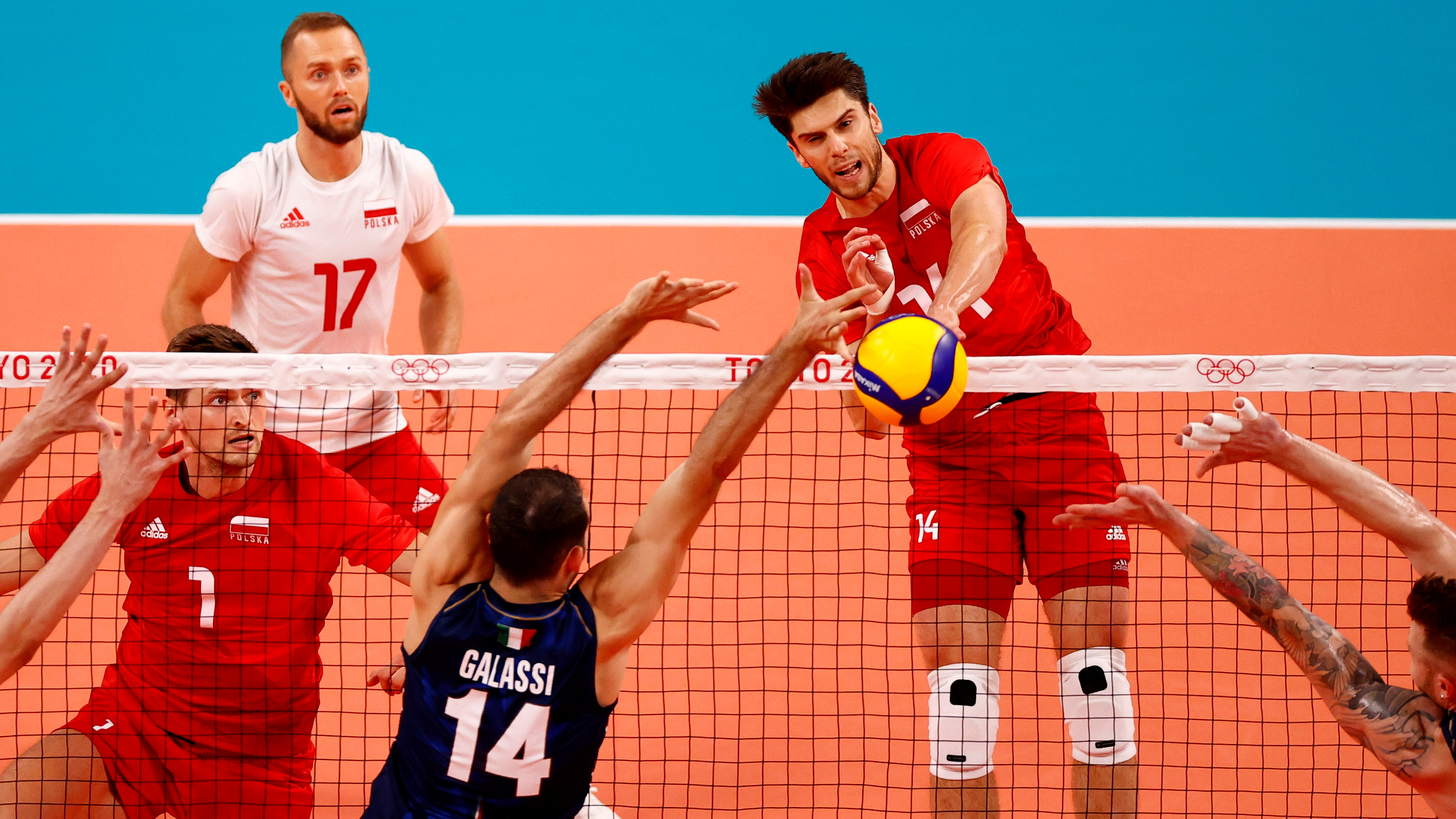 Tokyo 2020 Olympics - Volleyball - Men's Pool A - Poland v Italy - Ariake Arena, Tokyo, Japan – July 26, 2021. Aleksander Sliwka of Poland in action with Gianluca Galassi of Italy. REUTERS/Carlos Garcia Rawlins