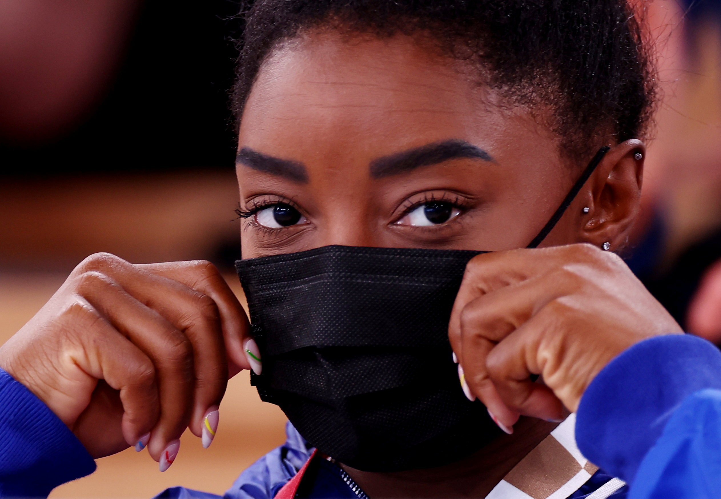 Tokyo 2020 Olympics - Gymnastics - Artistic - Men's Rings - Medal Ceremony - Ariake Gymnastics Centre, Tokyo, Japan - August 2, 2021. Simone Biles of the United States wearing a protective face mask looks on REUTERS/Mike Blake