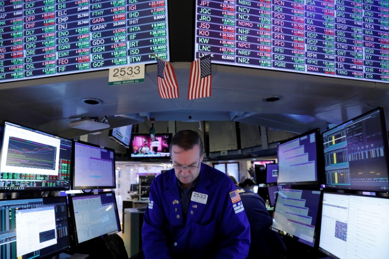 A trader works on the trading floor at the New York Stock Exchange (NYSE) in Manhattan, New York City, U.S., August 5, 2021. REUTERS/Andrew Kelly