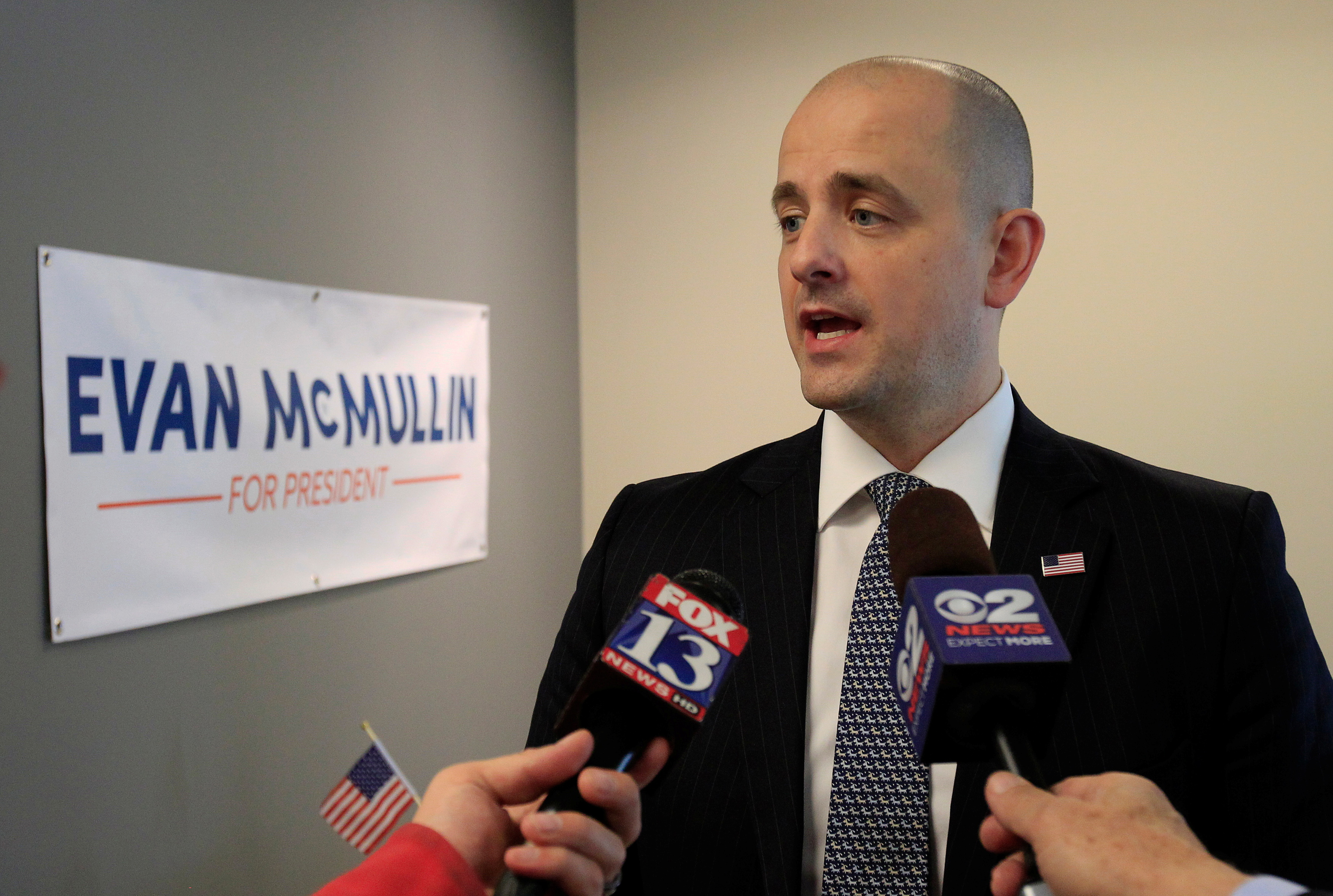 Third party candidate Evan McMullin, an independent, talks to the press as he campaigns in Salt Lake City, Utah, October 12, 2016.  REUTERS/George Frey/File Photo