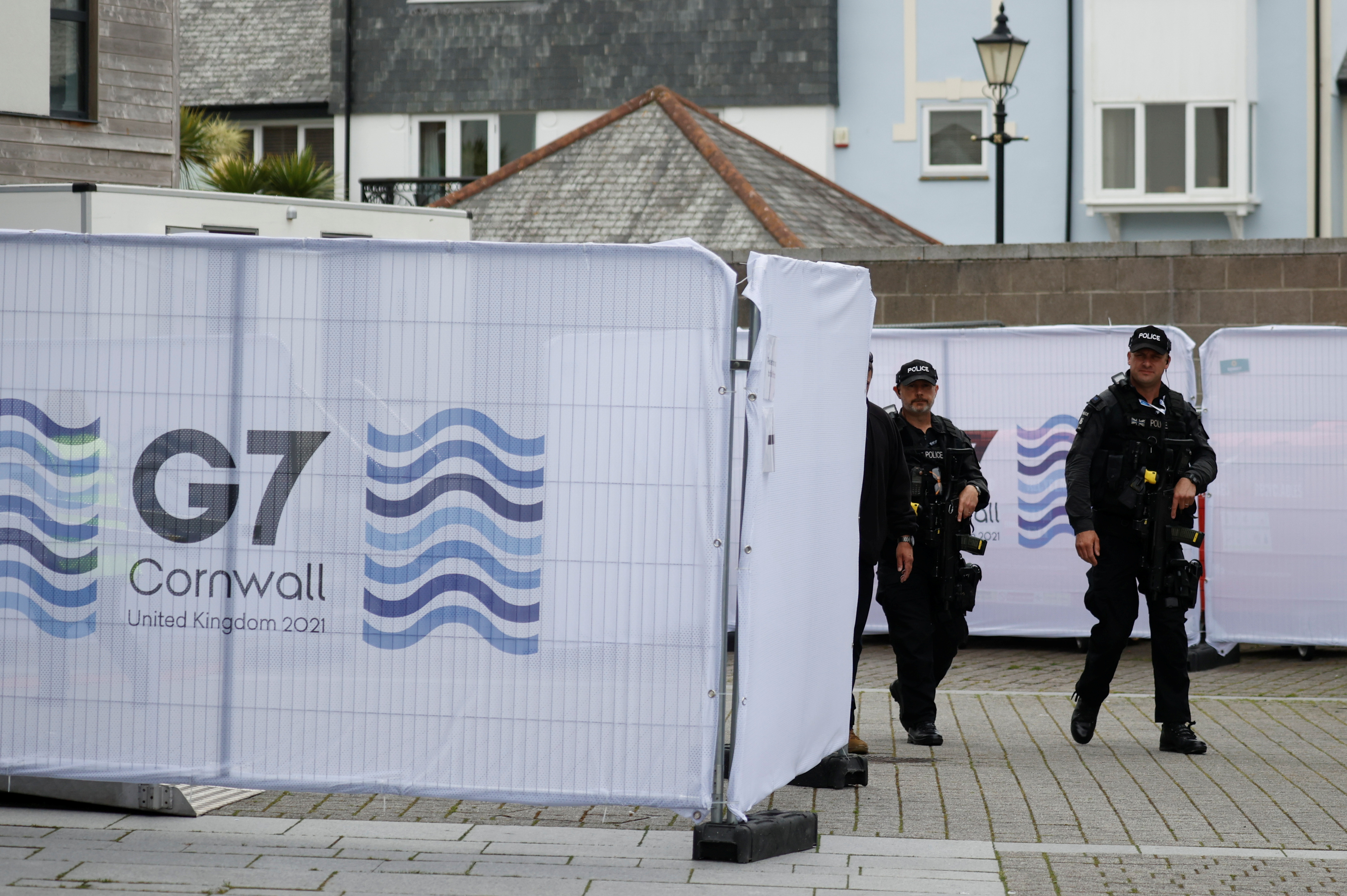 Armed police officers walk in Falmouth as preparations are underway for the G7 leaders summit, Cornwall, Britain, June 10, 2021. REUTERS/Phil Noble