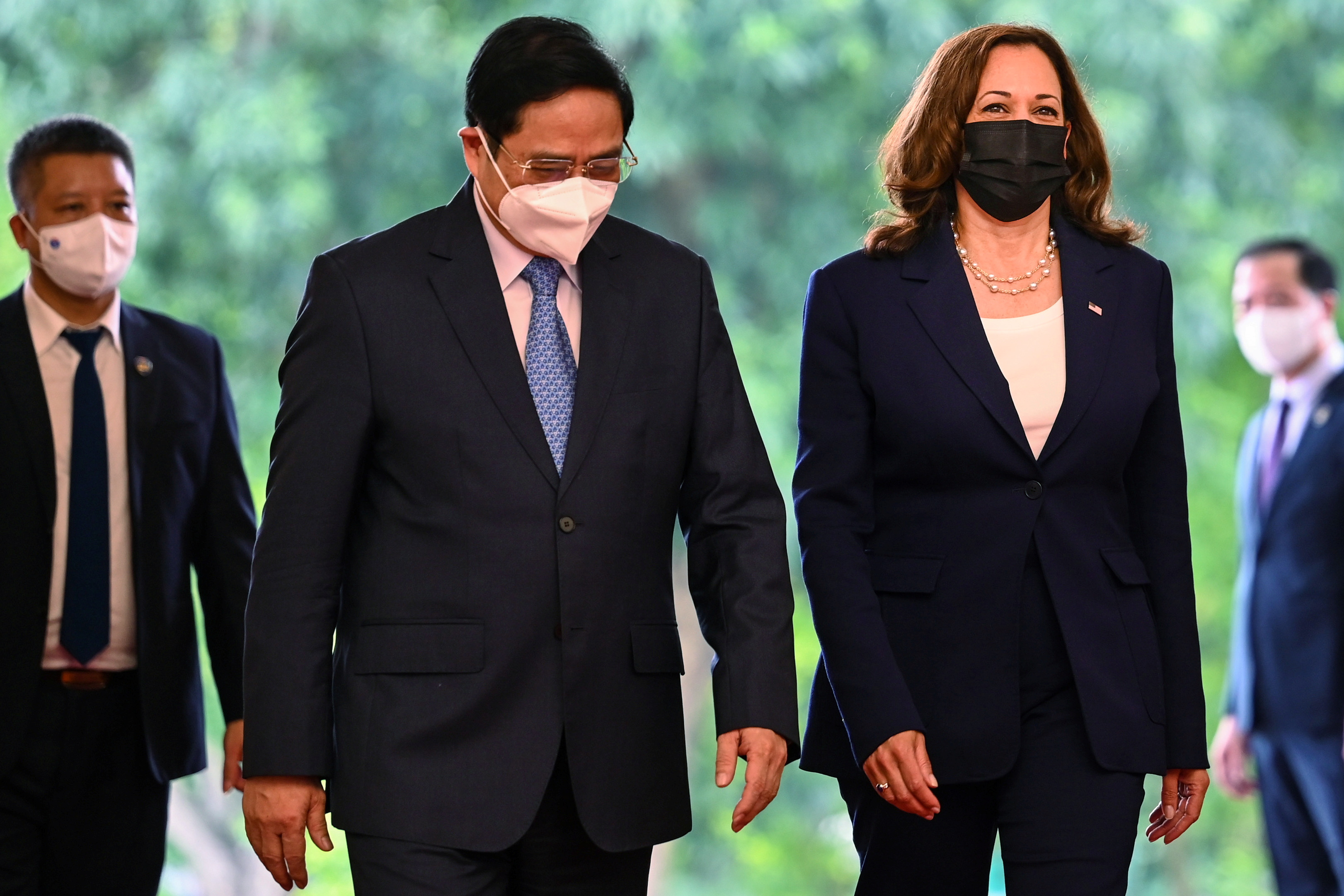U.S. Vice President Kamala Harris (2nd R) walks with Vietnam's Prime Minister Pham Minh Chinh (2nd L) at the Government office in Hanoi, Vietnam, August 25, 2021. Manan Vatsyayana/Pool via REUTERS