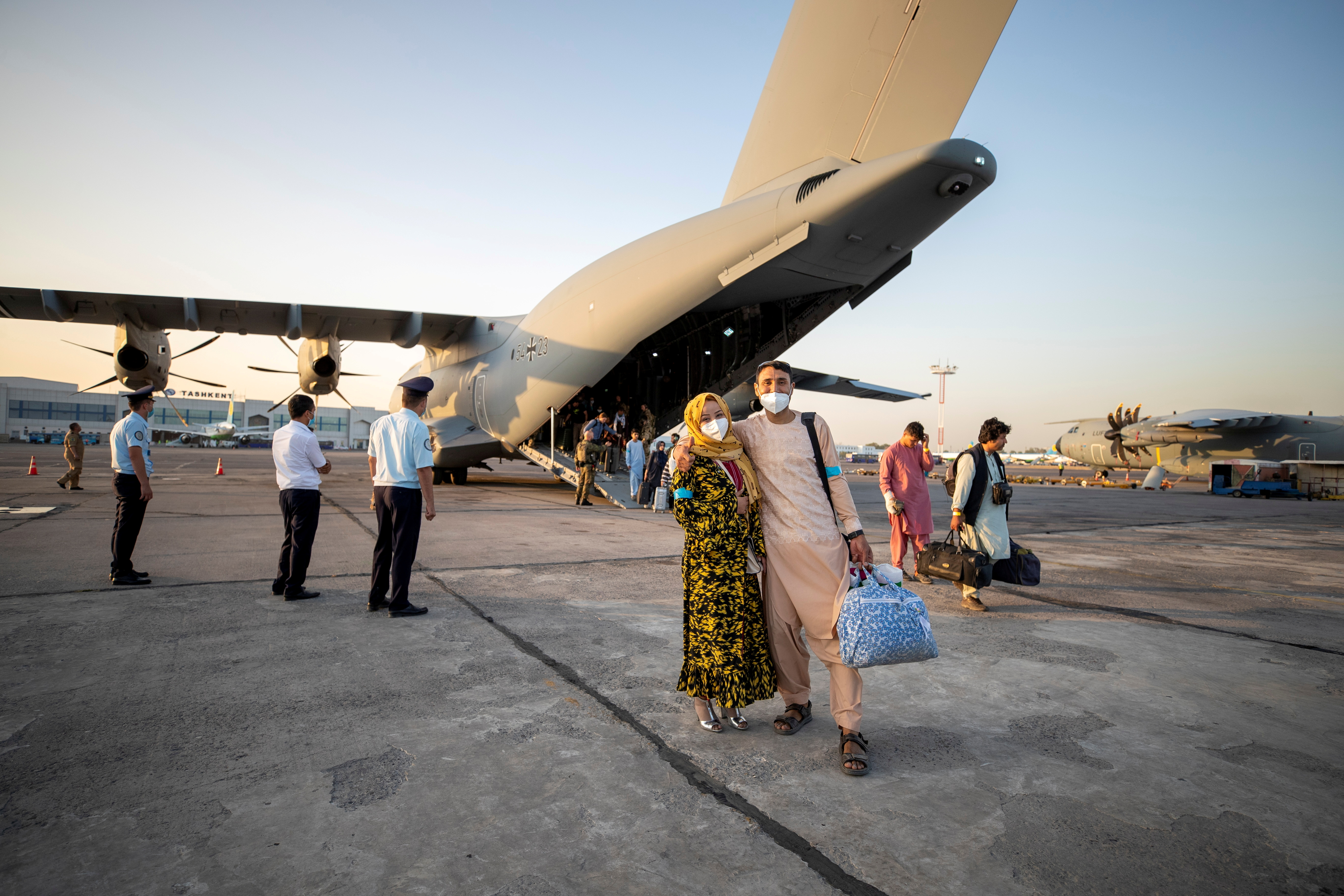 A handout photo obtained from Twitter via @Bw_Einsatz on August 17, 2021 shows evacuees from Afghanistan as they arrive in an Airbus A400 transport aircraft of the German Air Force Luftwaffe in Tashkent, Uzbekistan. Marc Tessensohn/Twitter @Bw_Einsatz/Handout via REUTERS