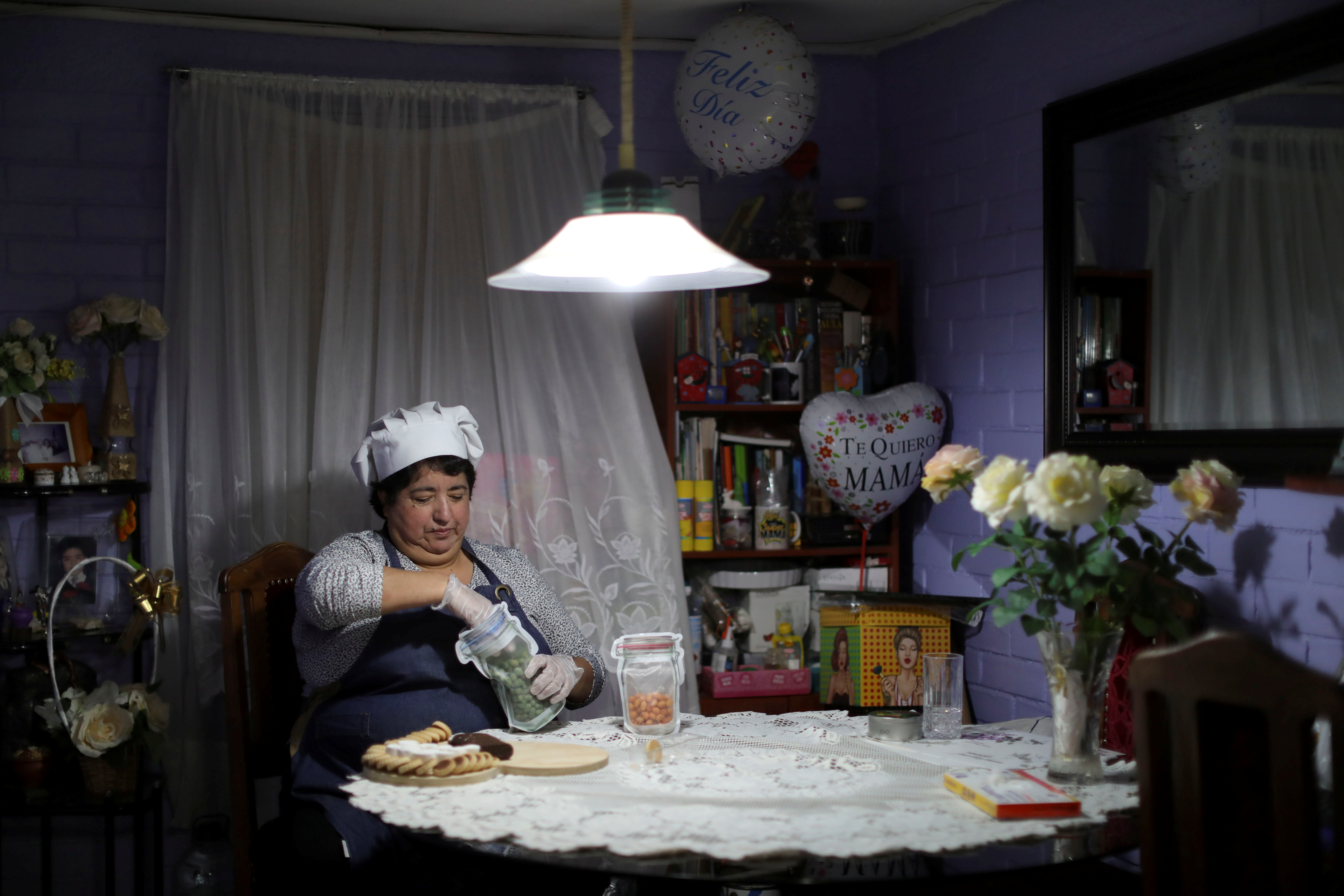 Rosa Navarro, 52, makes a tray with the breakfast she prepares to sell, after the coronavirus disease (COVID-19) restrictions affected her work, in Santiago, Chile September 7, 2021. Latin America's mothers are lagging behind in the pandemic of economic recovery, returning to the labor force more slowly than men, in a trend that experts say could set back female labor force participation for a decade across the region. Picture taken September 7, 2021. REUTERS/Pablo Sanhueza