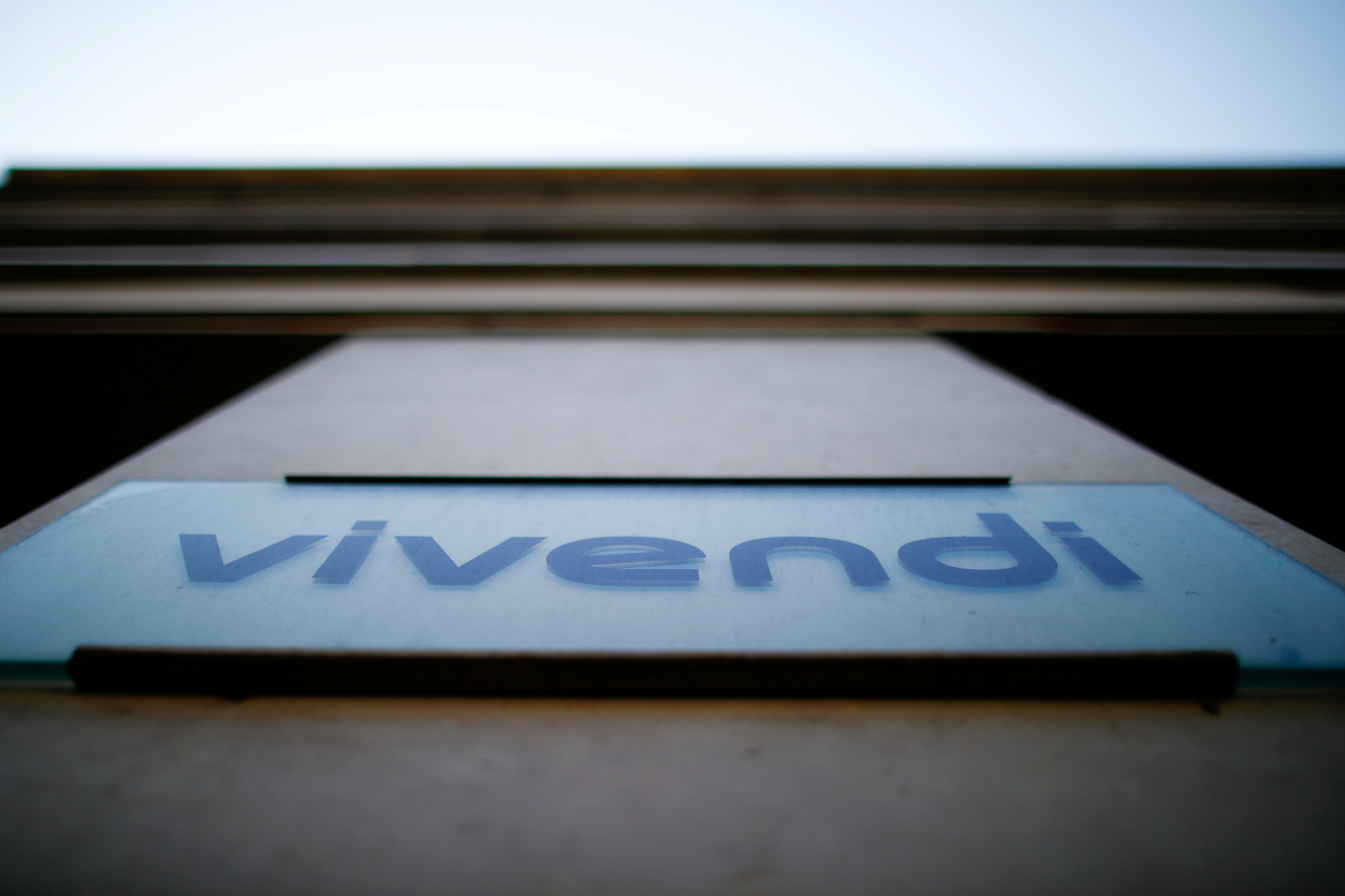 The logo of Vivendi is pictured at the main entrance of the entertainment-to-telecoms conglomerate headquarters in Paris, France, April 22, 2021. REUTERS/Gonzalo Fuentes/File Photo